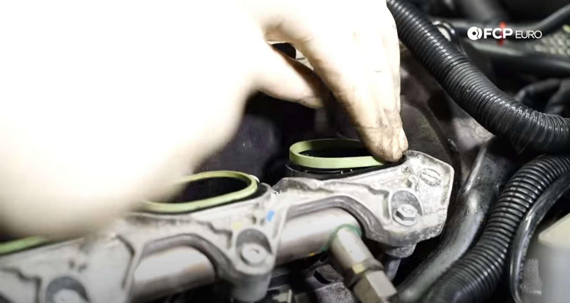 DIY Audi 3.0T Supercharger Oil Change installing the new supercharger gaskets