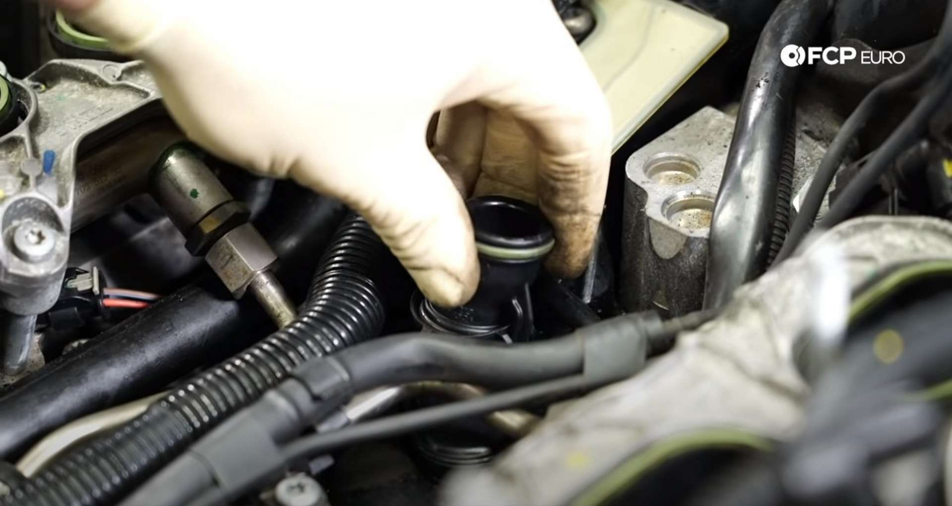 DIY Audi 3.0T Supercharger Oil Change installing the new breather pipe