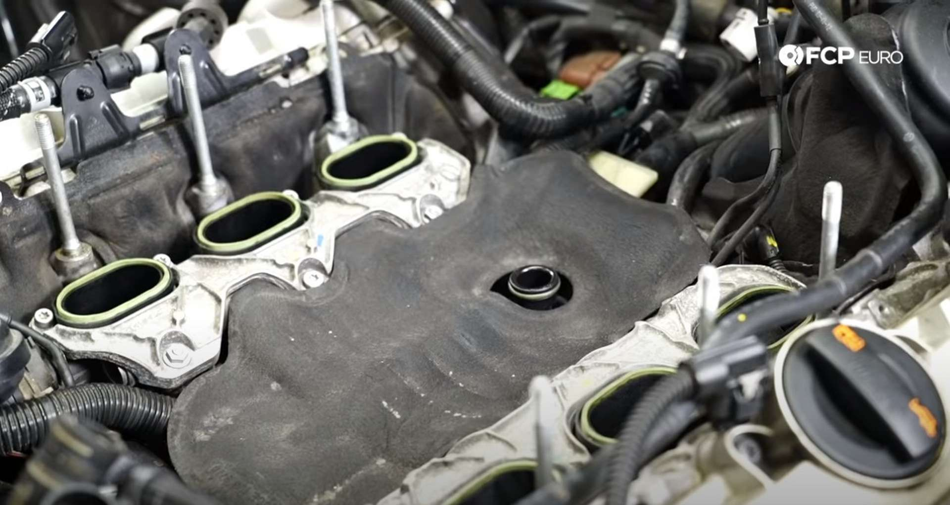 DIY Audi 3.0T Supercharger Oil Change installing the engine valley cover