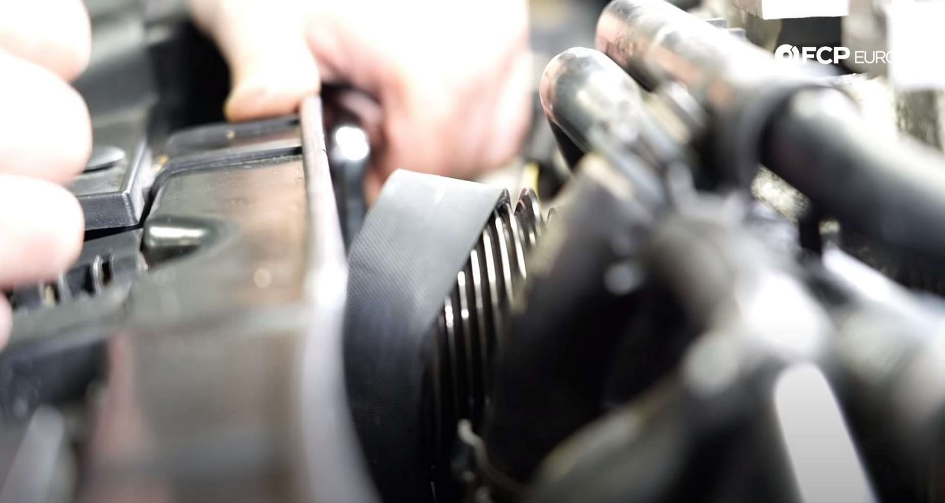 DIY Audi 3.0T Supercharger Oil Change fitting the supercharger belt