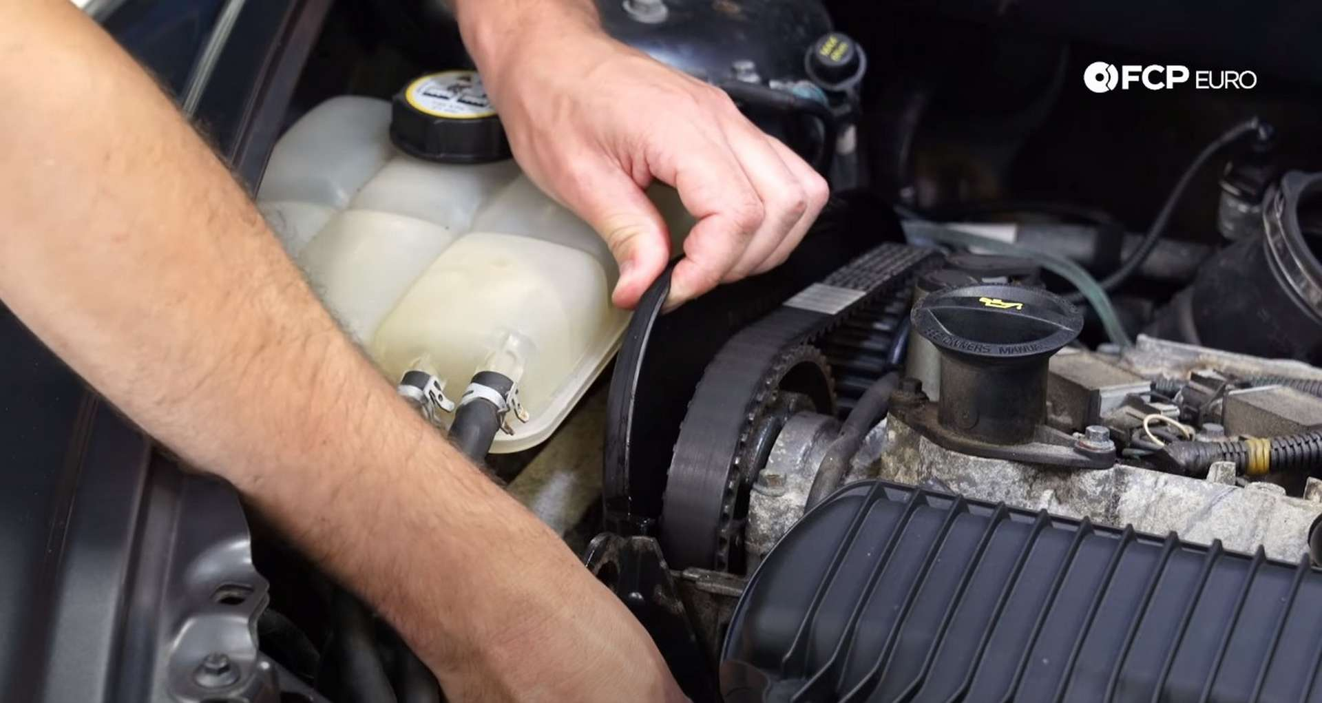 DIY Volvo P1 Water Pump Replacement removing the camshaft sprocket shield