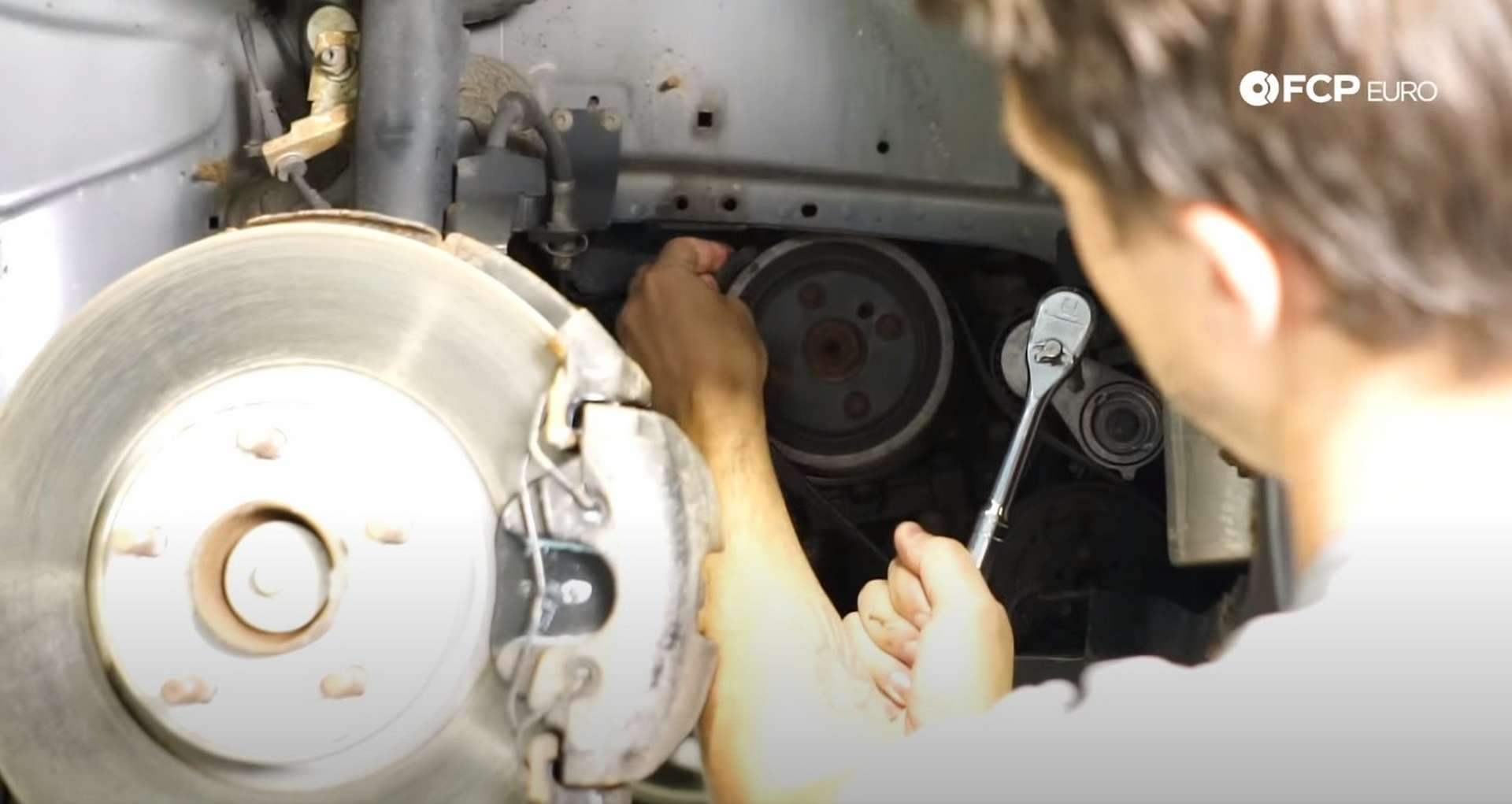 DIY Volvo P1 Water Pump Replacement removing the a/c belt