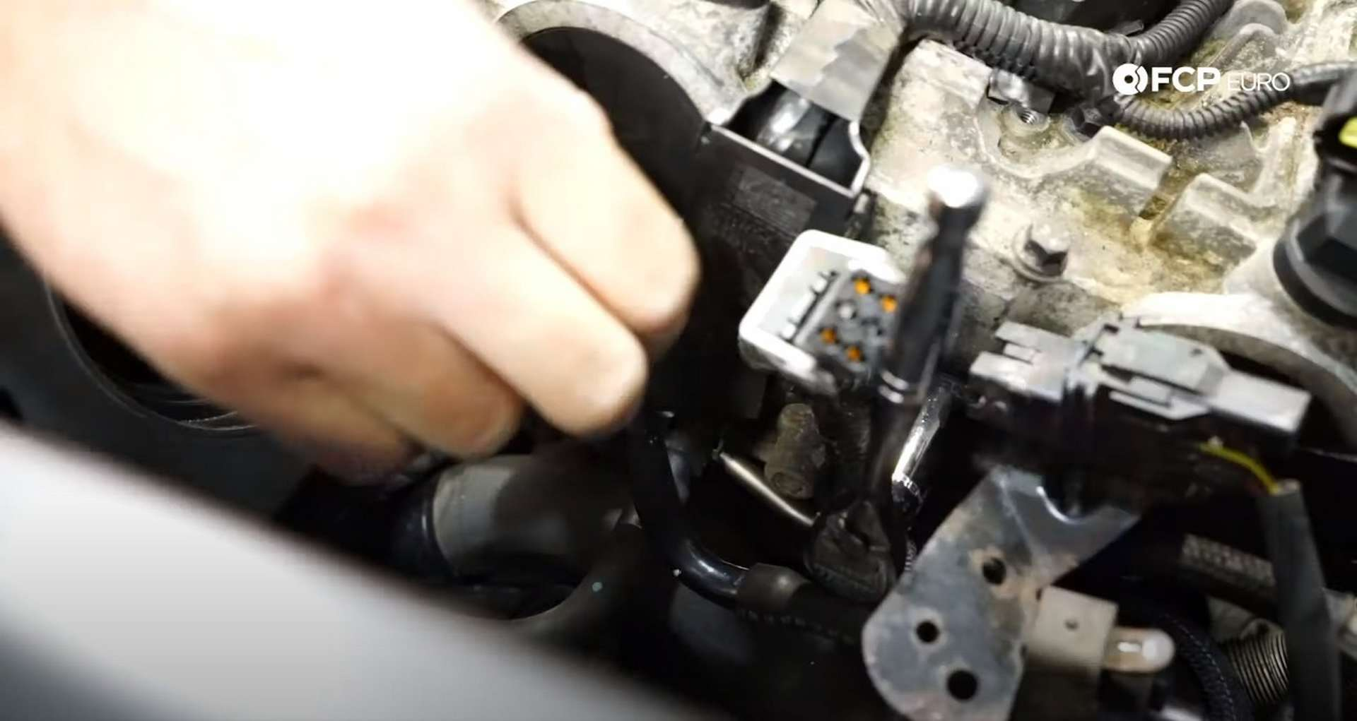 DIY Volvo P1 Water Pump Replacement removing the 13mm bolt