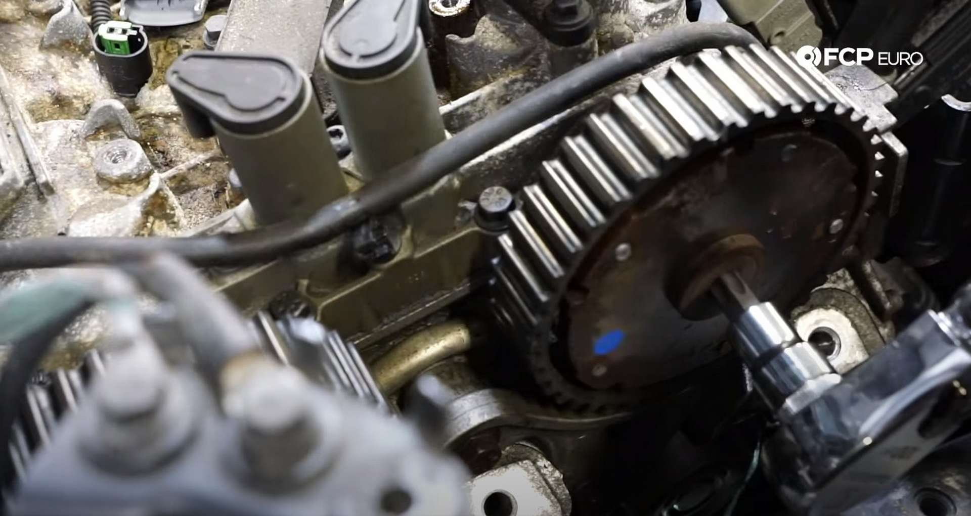 DIY Volvo P1 Water Pump Replacement removing the camshaft sprocket plug