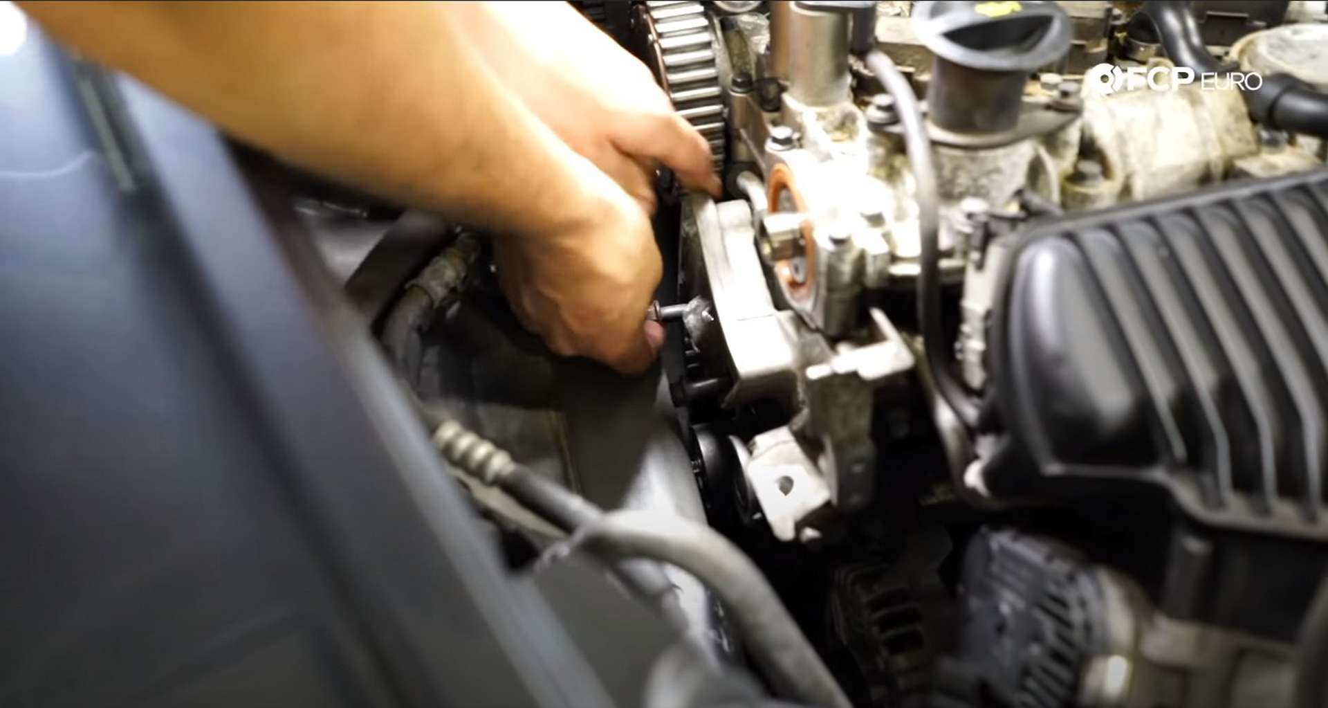DIY Volvo P1 Water Pump Replacement installing the engine mount bracket