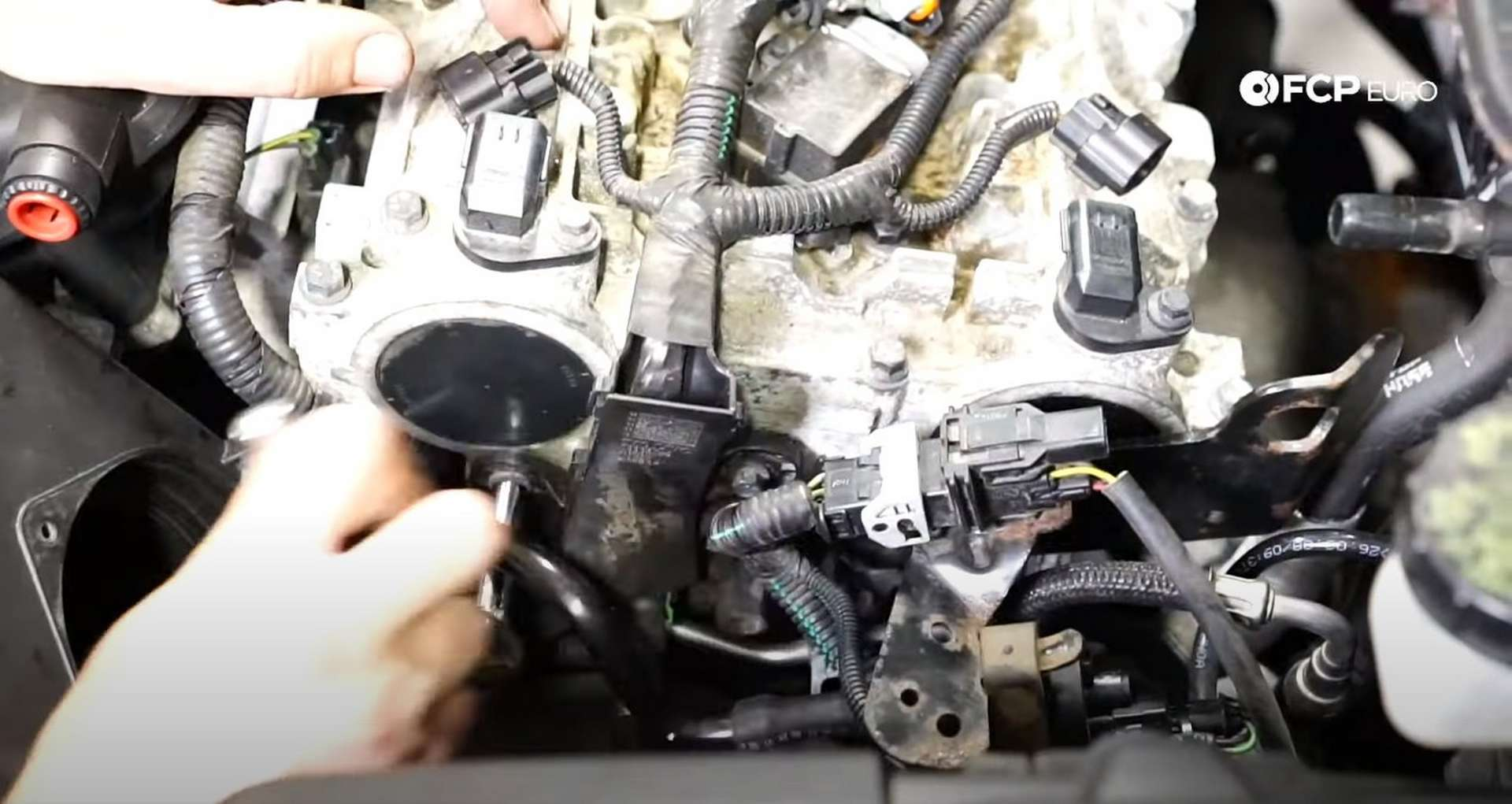 DIY Volvo P1 Water Pump Replacement reattaching the ignition coil harness to the cylinder head