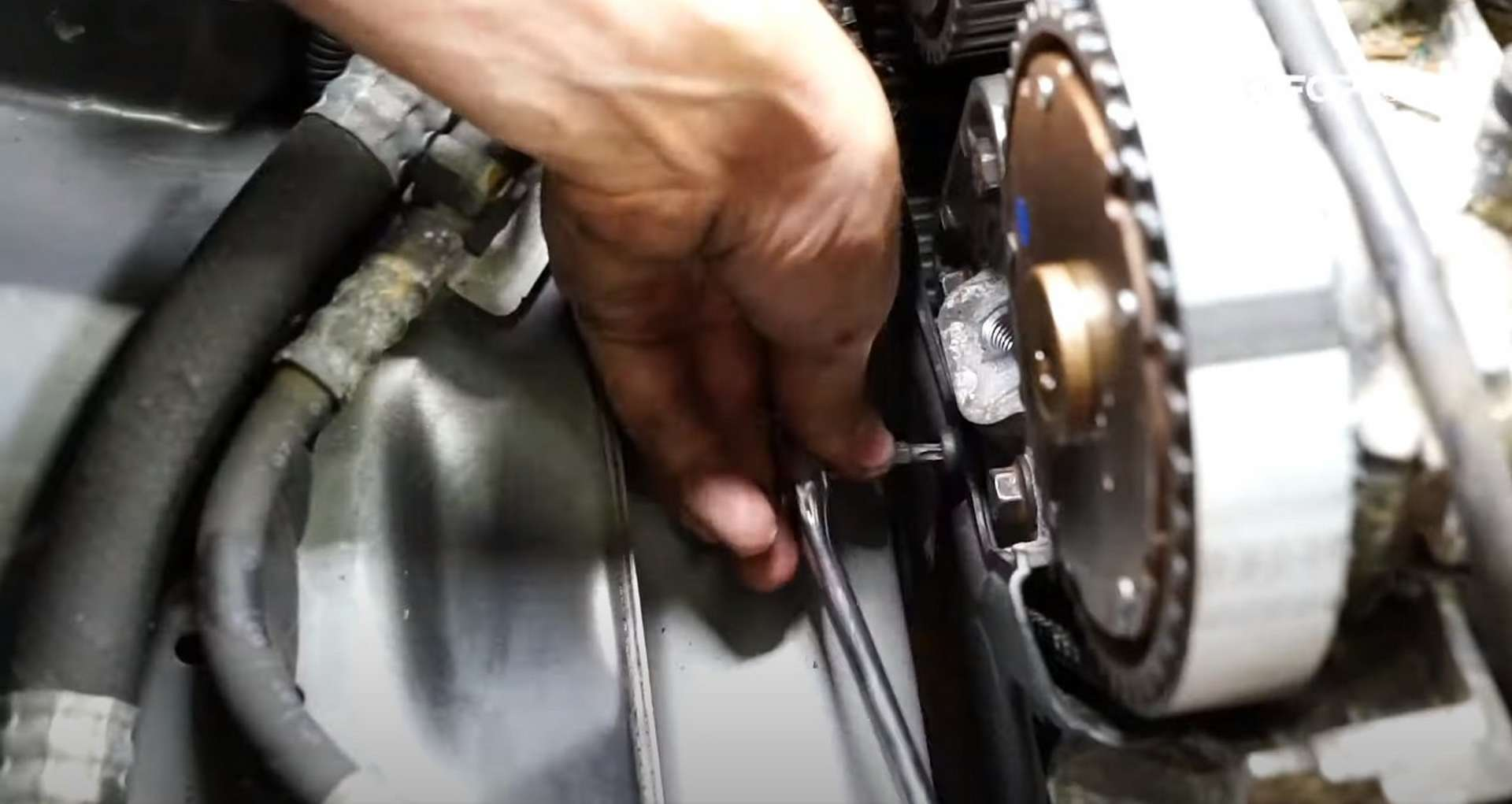 DIY Volvo P1 Water Pump Replacement installing the lower outer timing cover