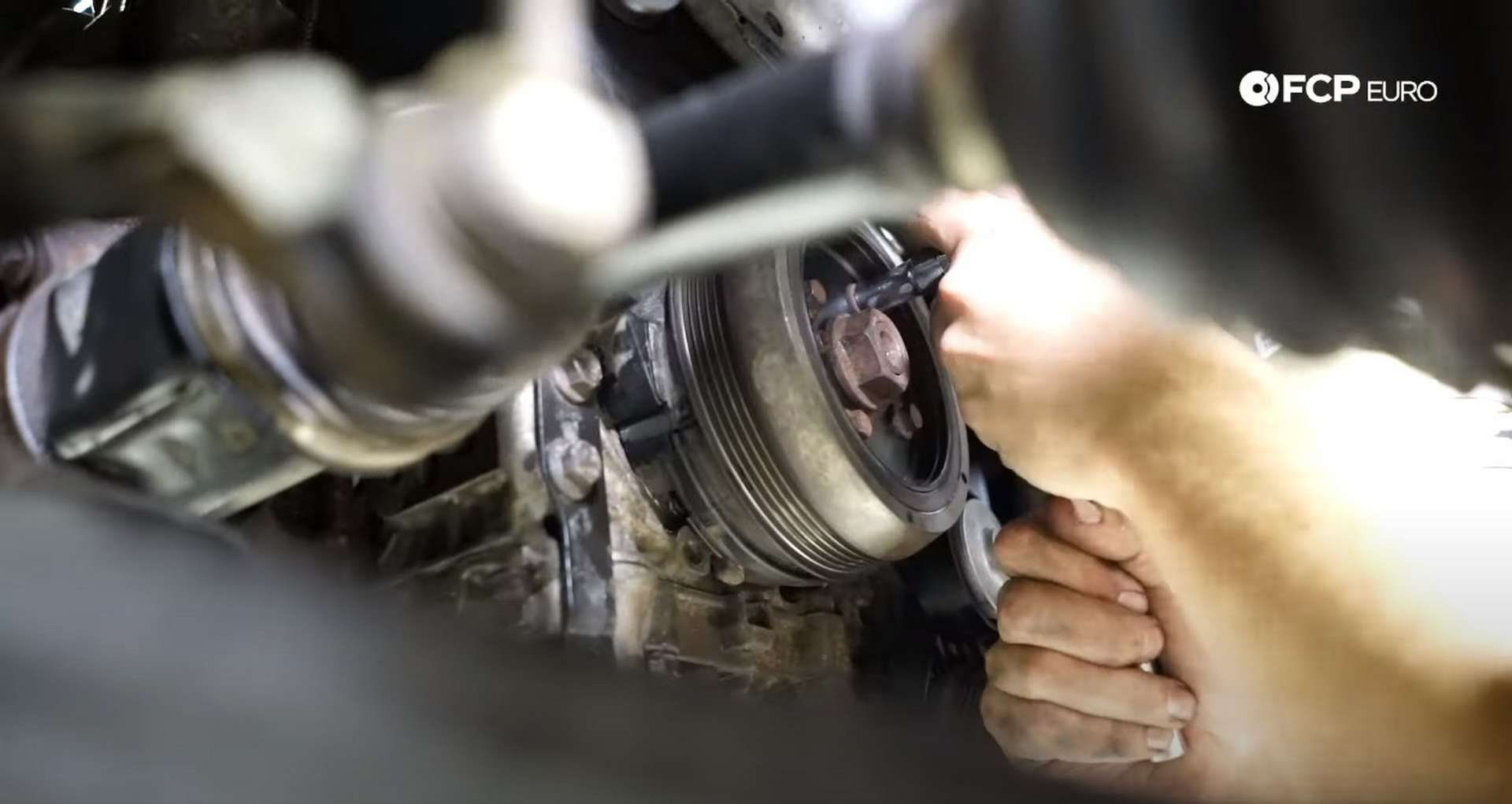 DIY Volvo P1 Water Pump Replacement refitting the crankshaft pulley