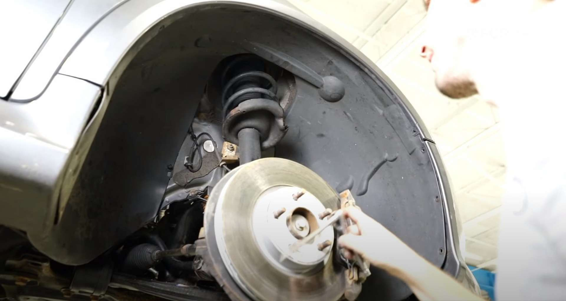DIY Volvo P1 Water Pump Replacement refitting the fender liner