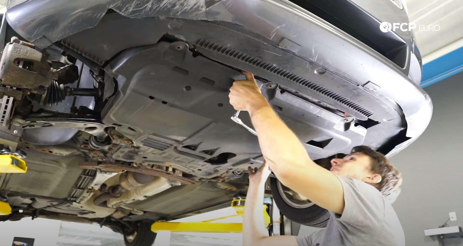 DIY Volvo P1 Water Pump Replacement installing the splash shield