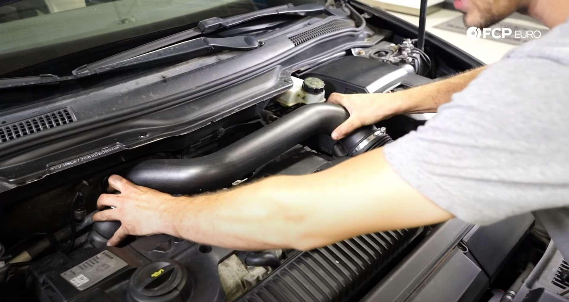 DIY Volvo P1 Water Pump Replacement installing the intake tube