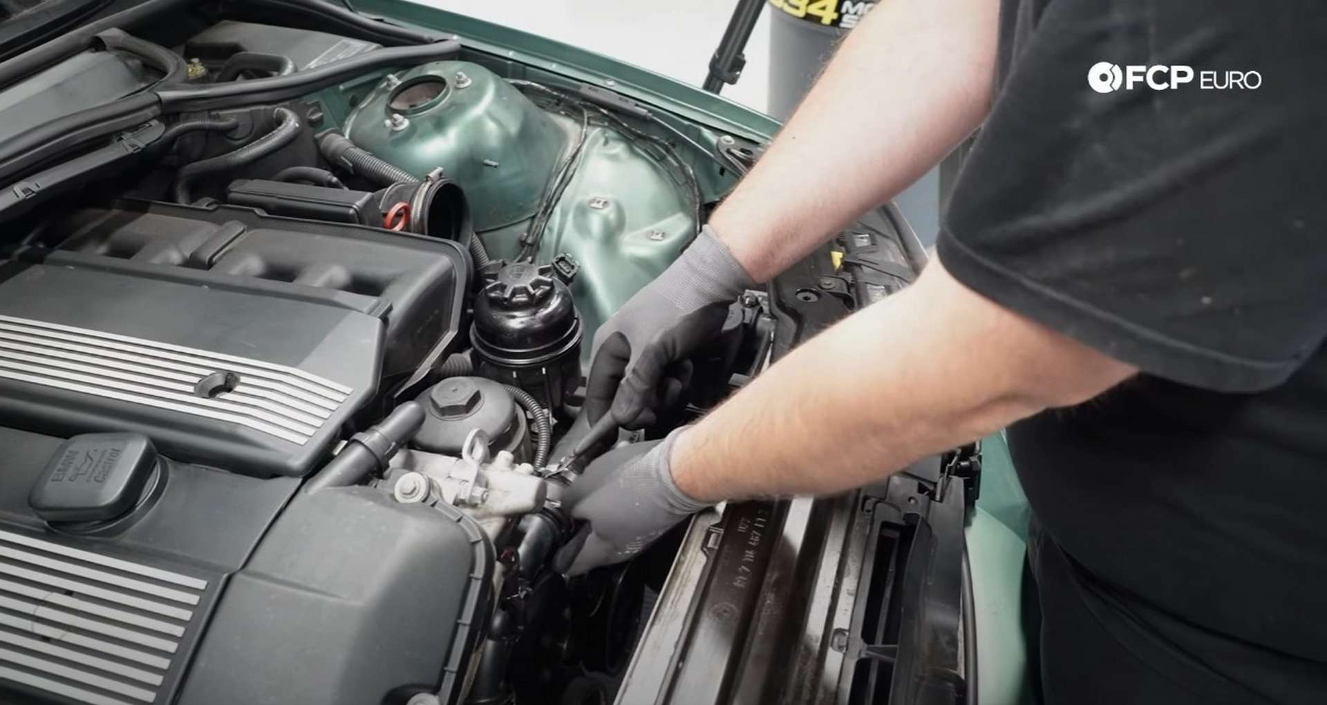 DIY BMW E46 Oil Filter Housing Gasket and VANOS Line Replacement clipping the VANOS wiring zip tie