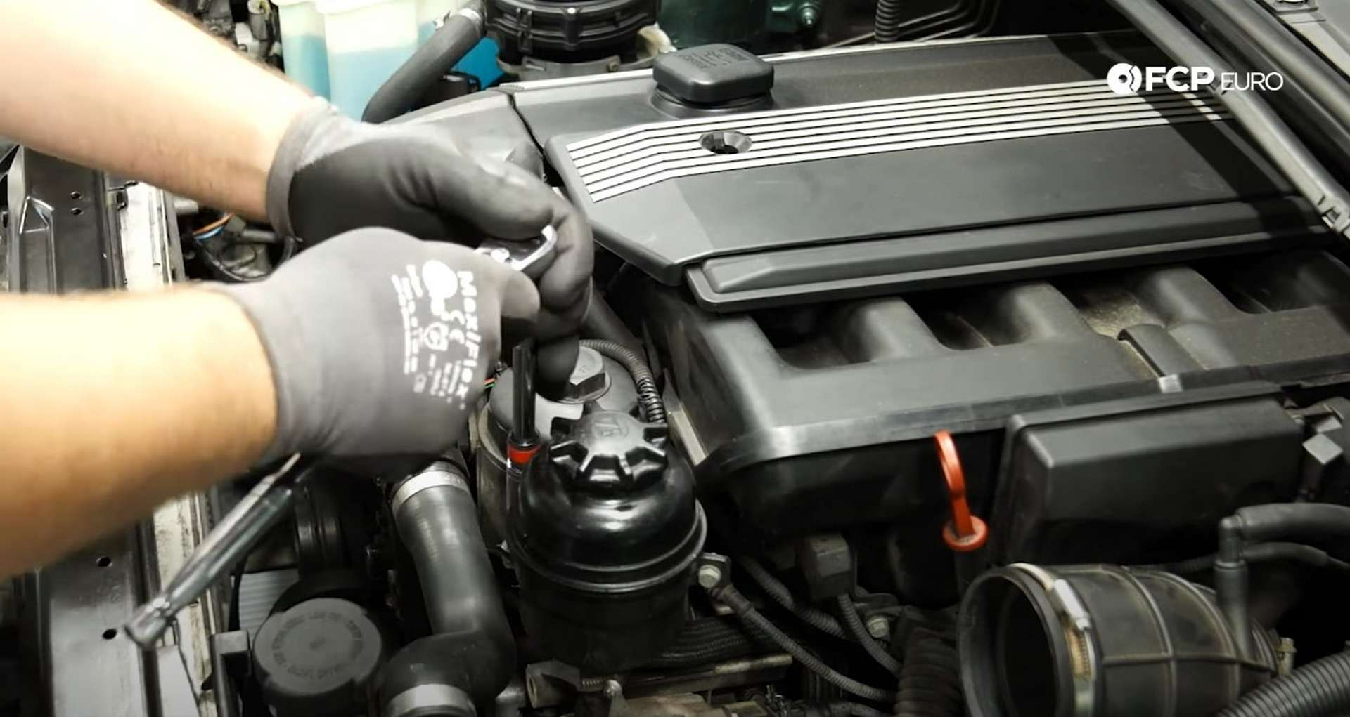 DIY BMW E46 Oil Filter Housing Gasket and VANOS Line Replacement removing the power steering reservoir bolts