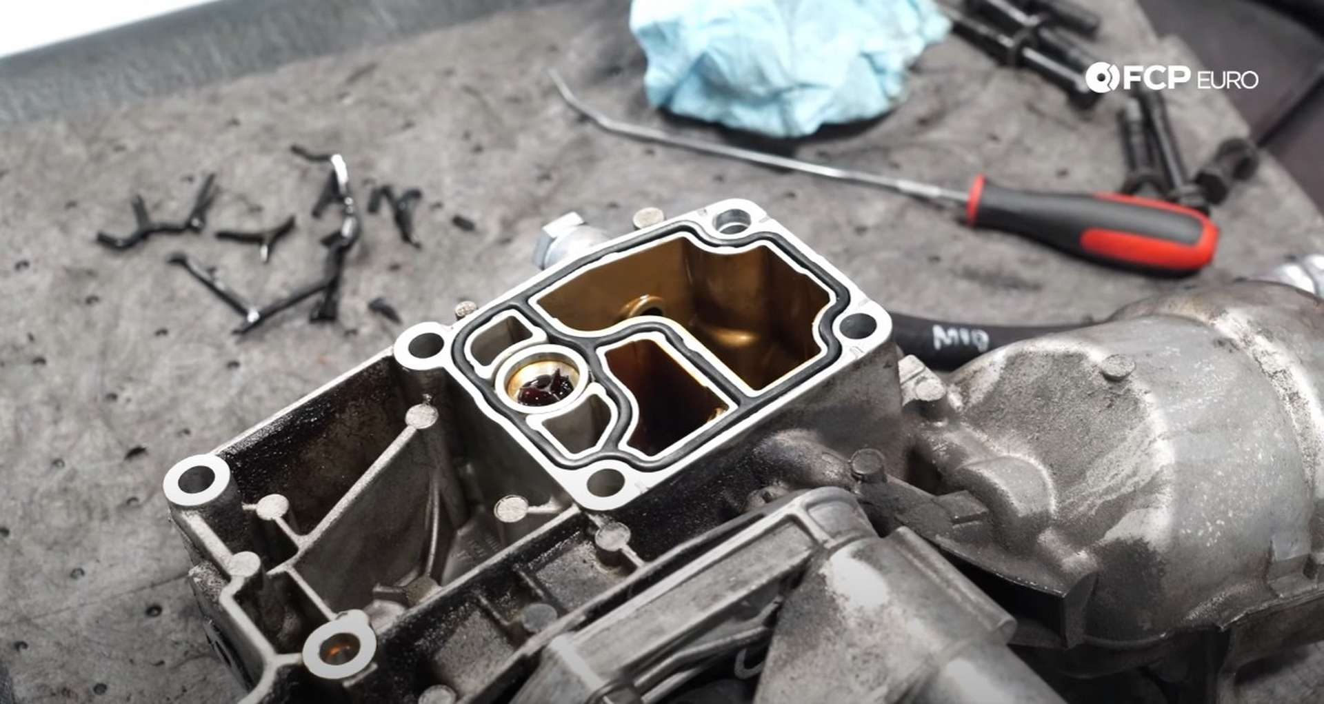 DIY BMW E46 Oil Filter Housing Gasket and VANOS Line Replacement the new gasket installed in the housing