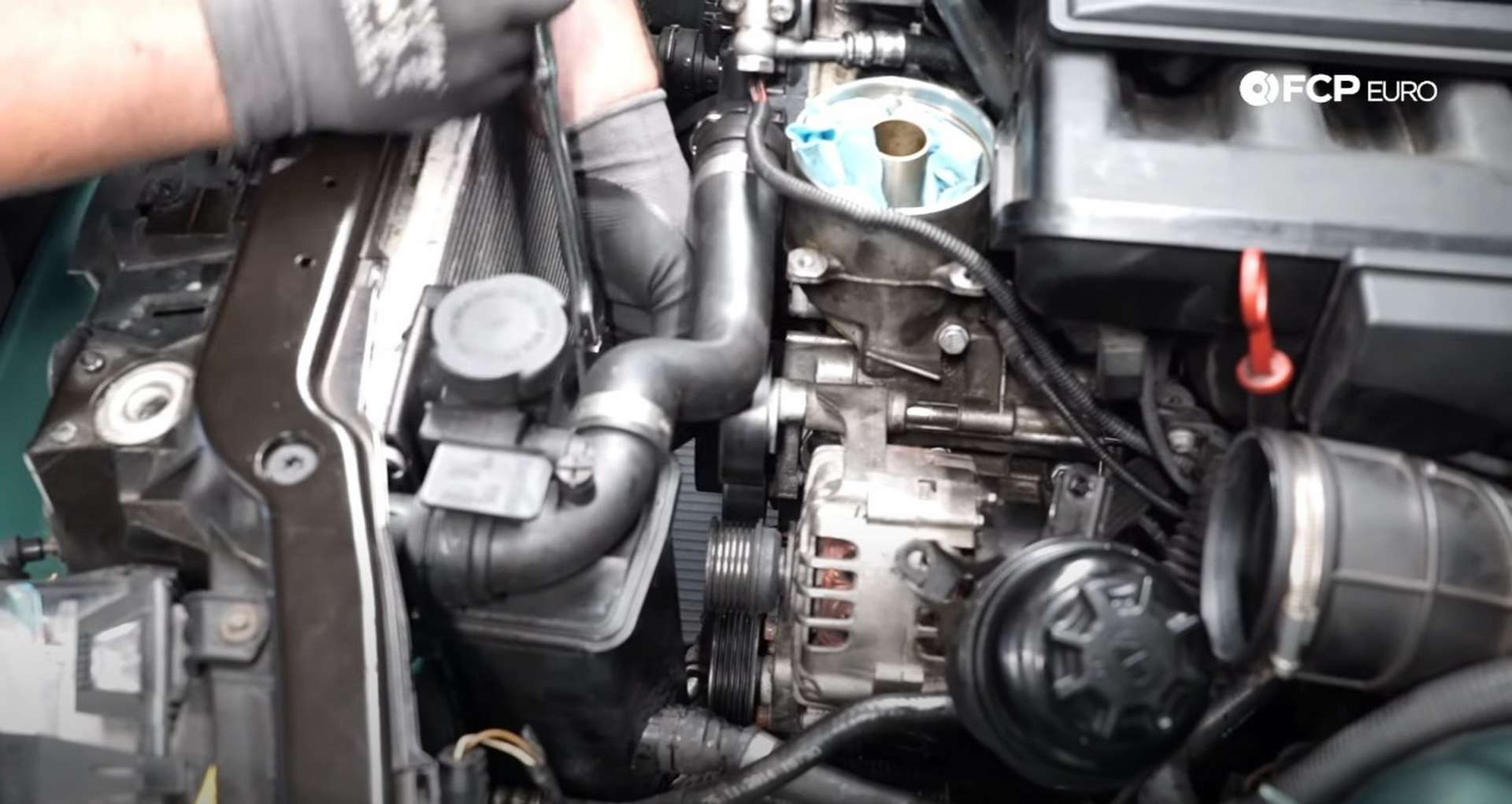 DIY BMW E46 Oil Filter Housing Gasket and VANOS Line Replacement installing the belt idler