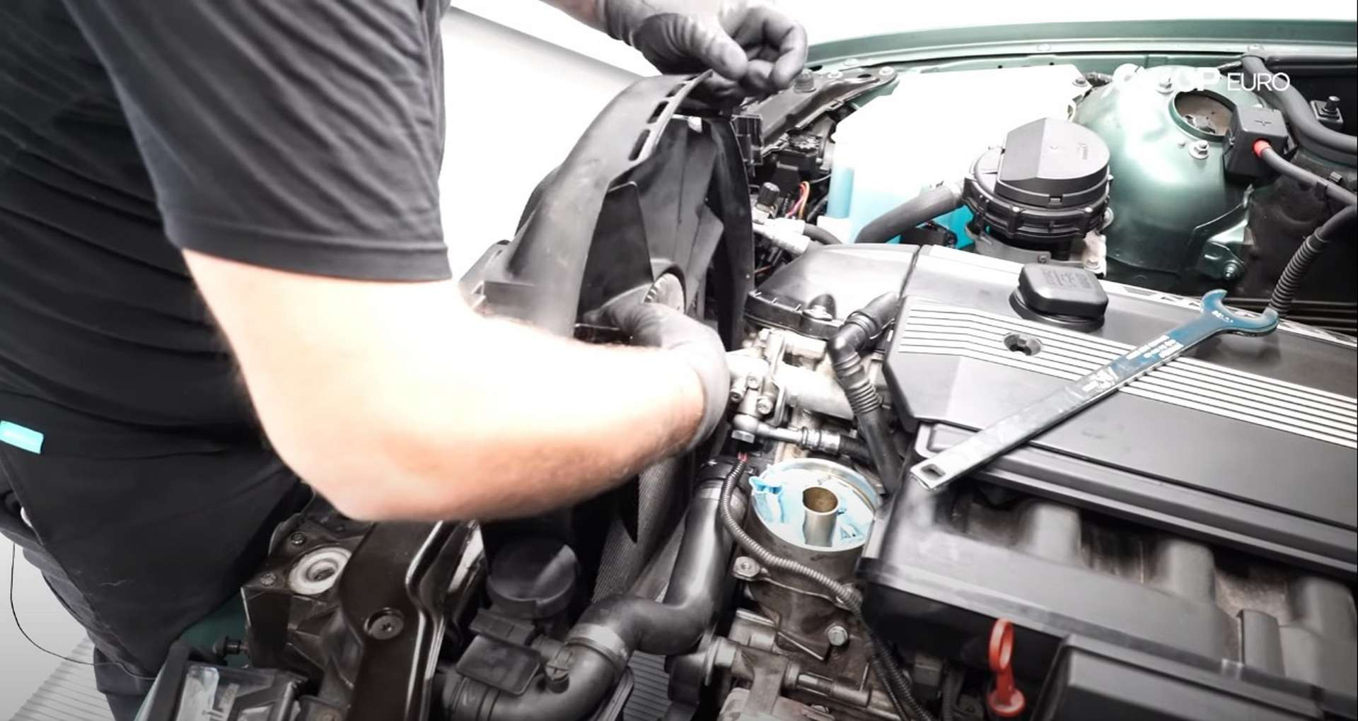 DIY BMW E46 Oil Filter Housing Gasket and VANOS Line Replacement installing the fan assembly