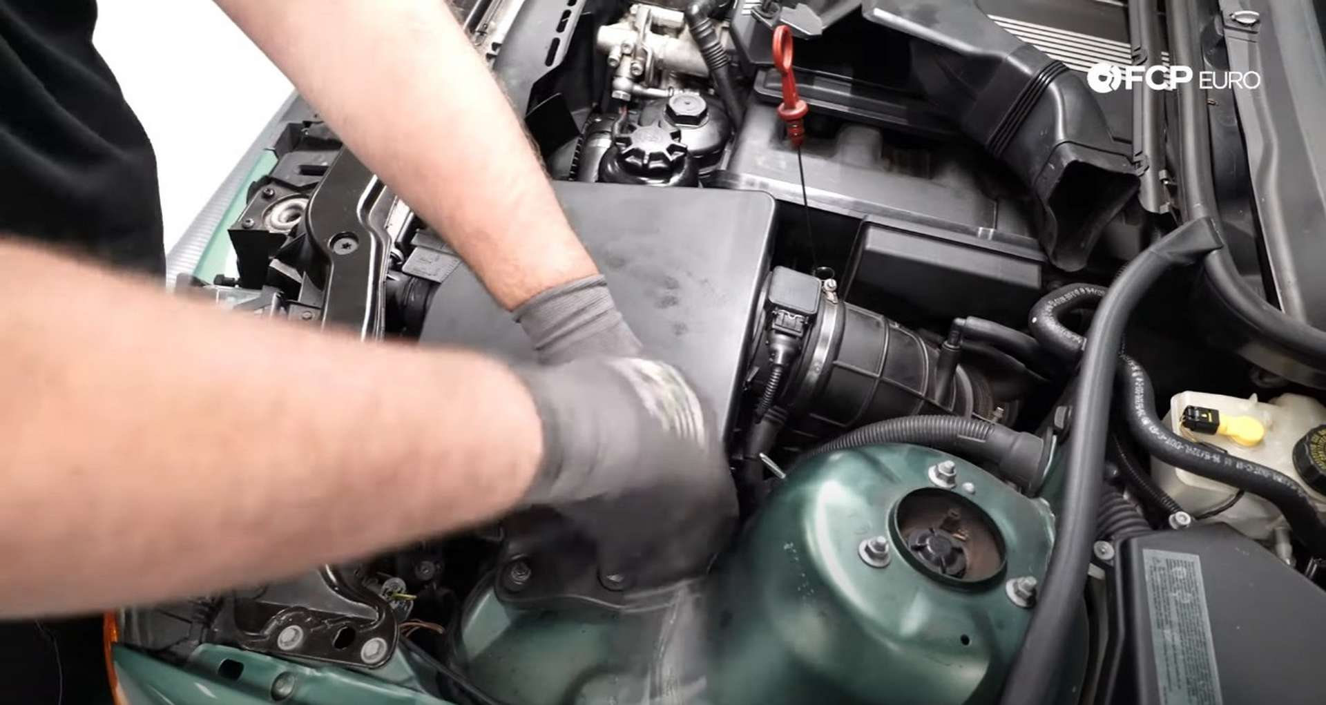 DIY BMW E46 Oil Filter Housing Gasket and VANOS Line Replacement reinstalling the airbox