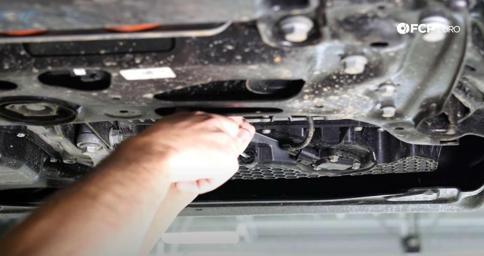 DIY Volkswagen EA888 Oil Change removing the drain plug