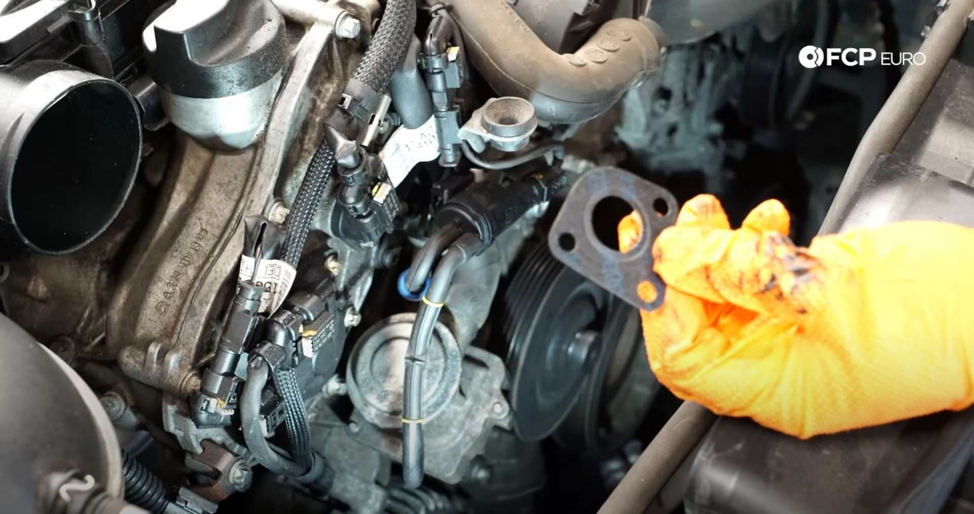 DIY Mercedes W212/204 Alternator and Drive Belt Replacement showing the positioning of the combi valve bolts