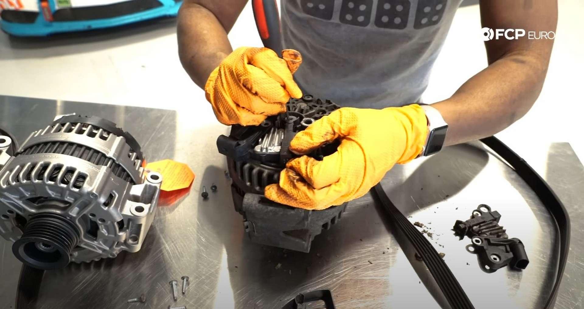 DIY Mercedes W212/204 Alternator and Drive Belt Replacement installing the new voltage regulator
