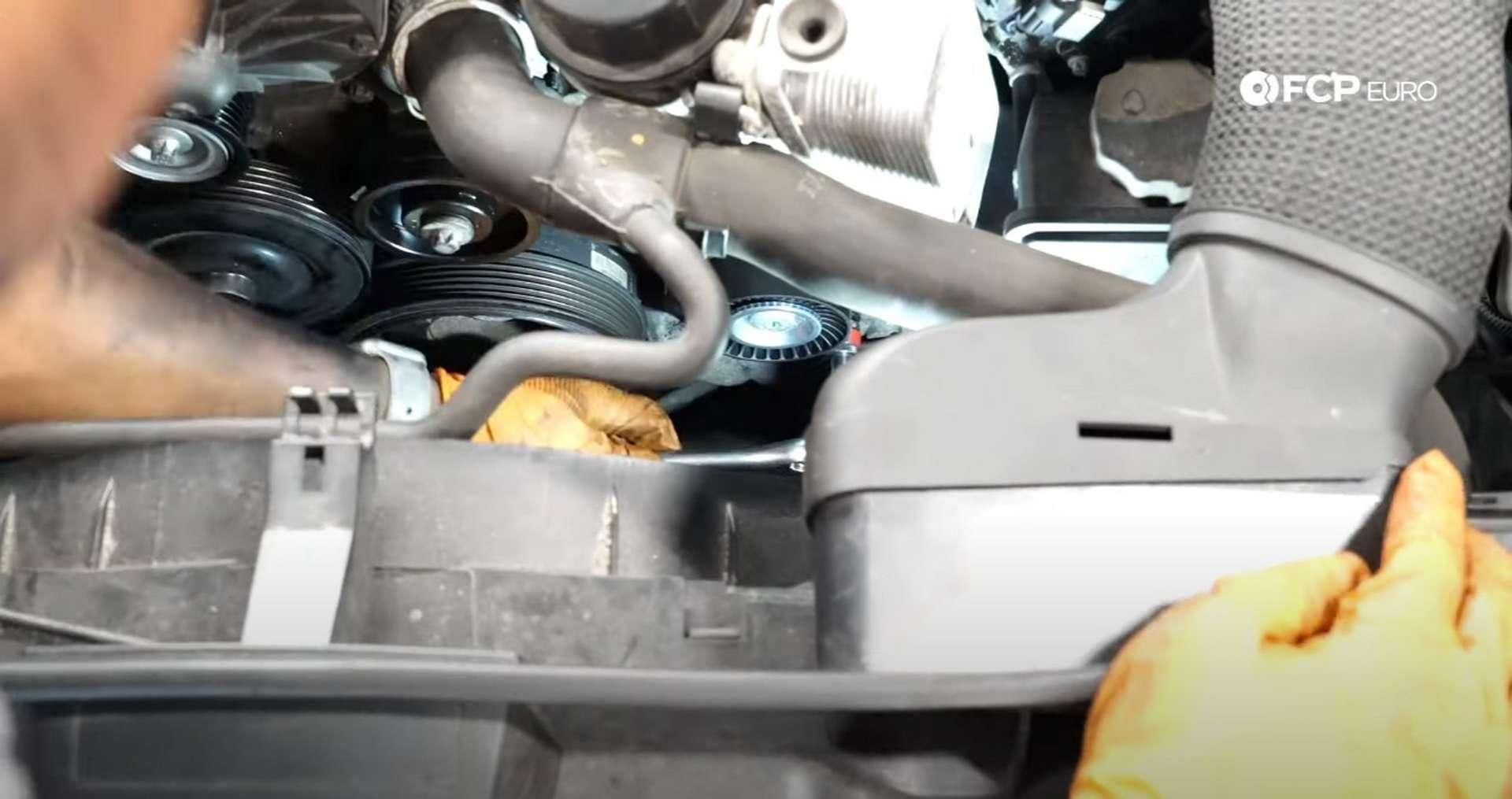 DIY Mercedes W212/204 Alternator and Drive Belt Replacement installing the belt tensioner]