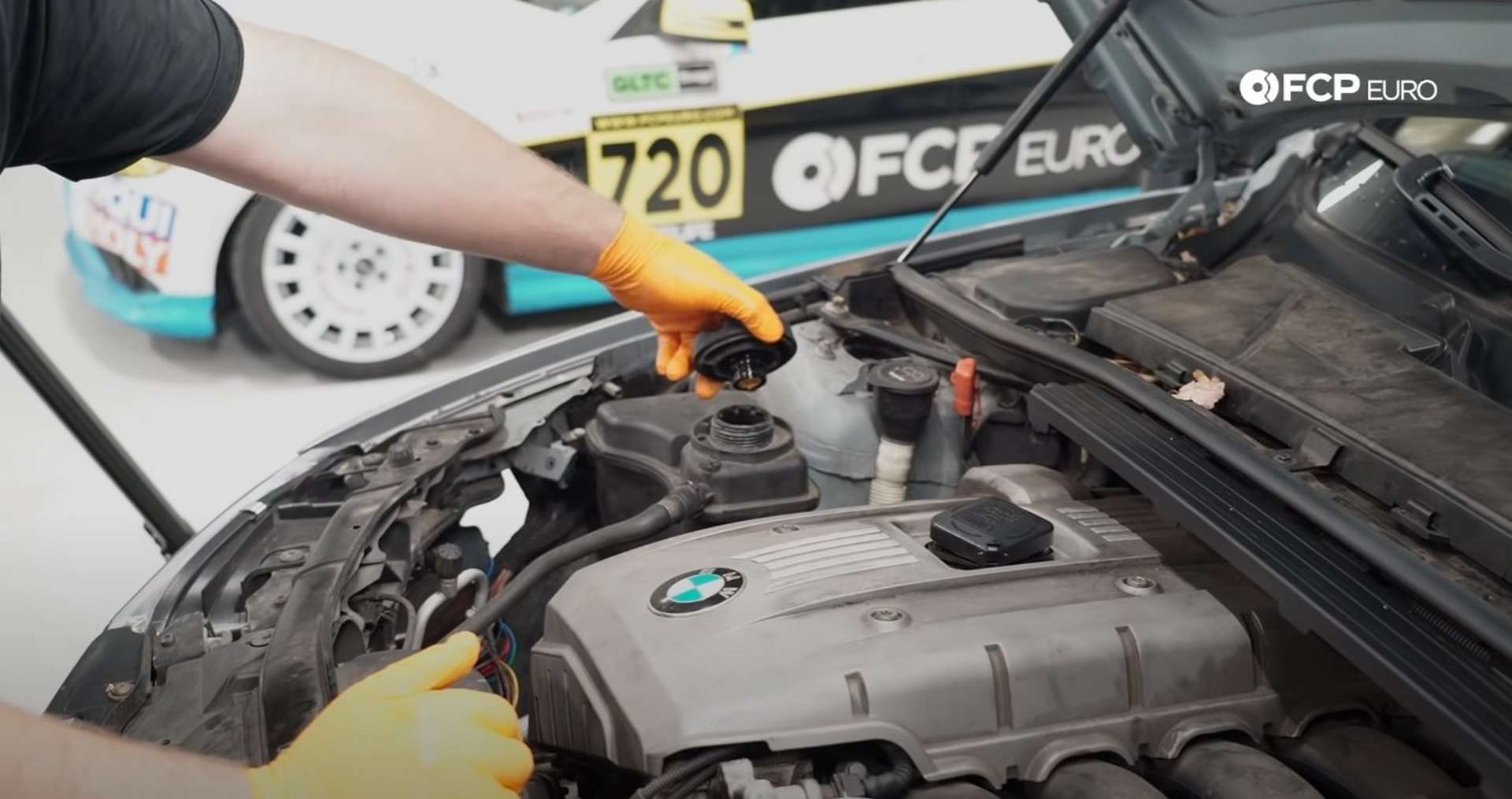 DIY BMW E9X Oil Filter Gasket Replacement removing the coolant expansion tank cap