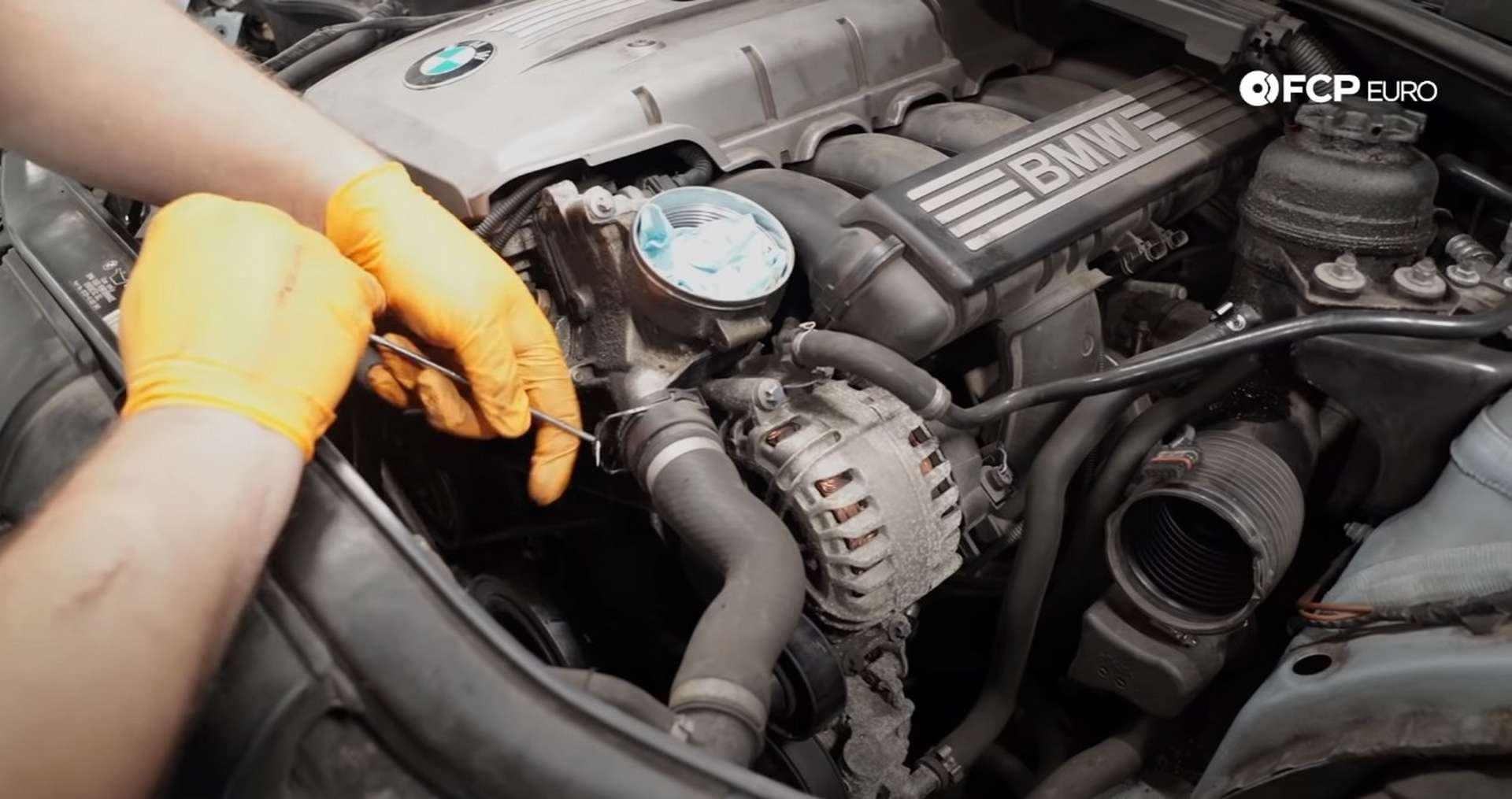 DIY BMW E9X Oil Filter Gasket Replacement removing the upper rad hose