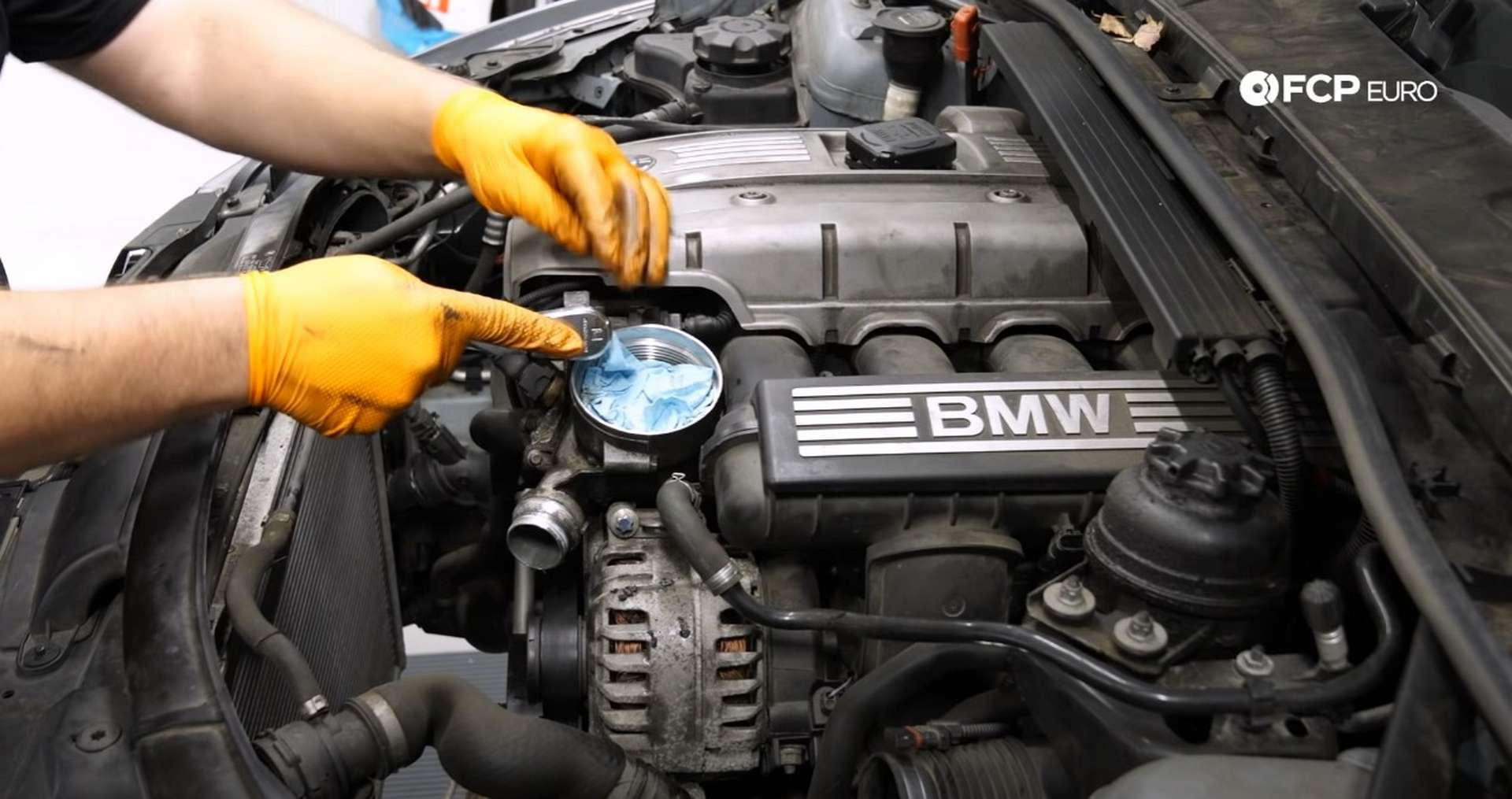 DIY BMW E9X Oil Filter Gasket Replacement removing the top mounting bolt