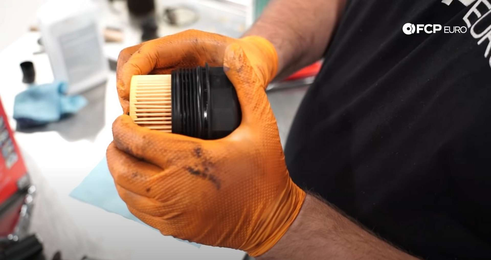 DIY BMW E9X Oil Filter Gasket Replacement installing a new filter into the cap