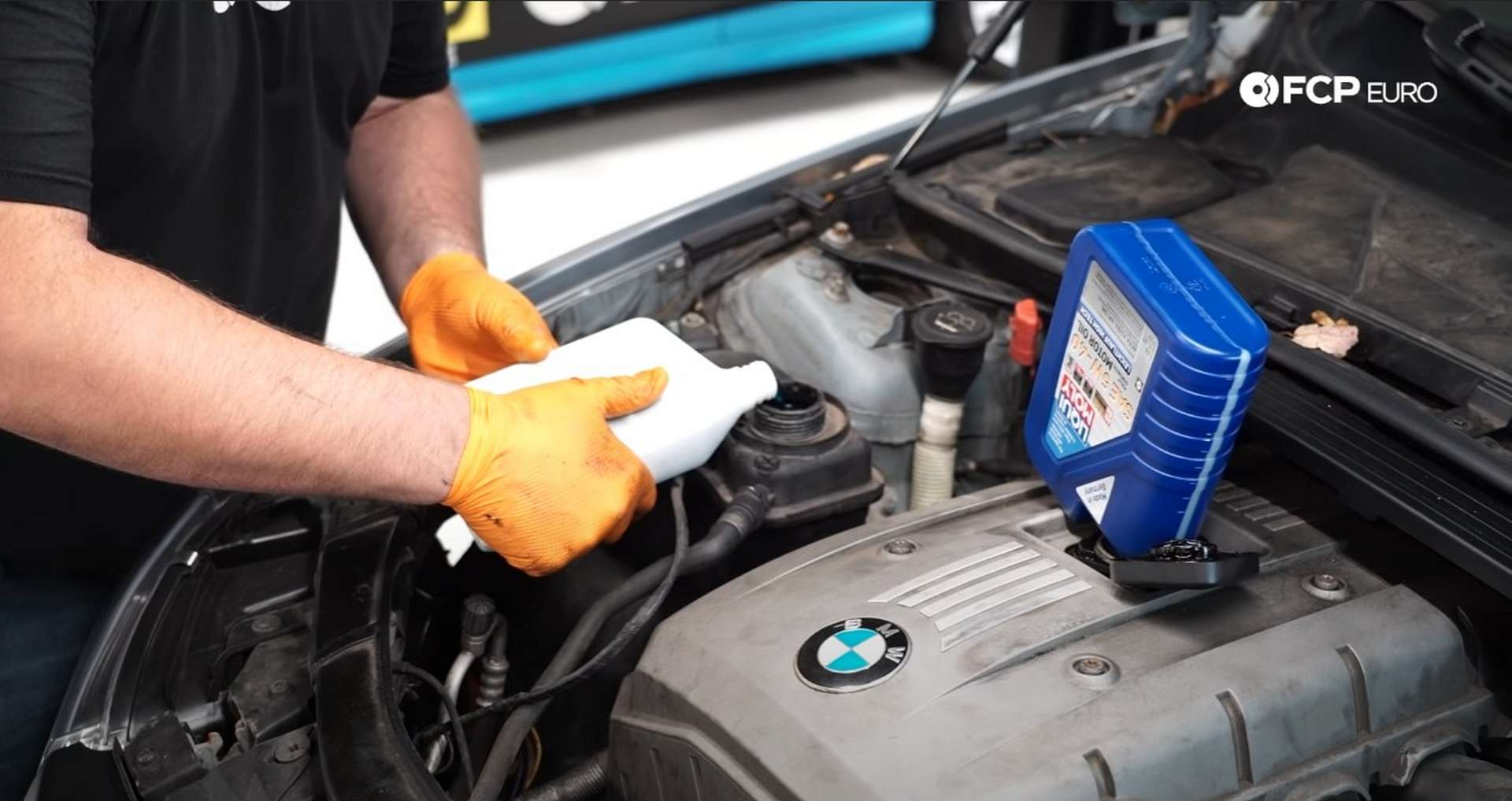 DIY BMW E9X Oil Filter Gasket Replacement filling the engine with coolant and oil