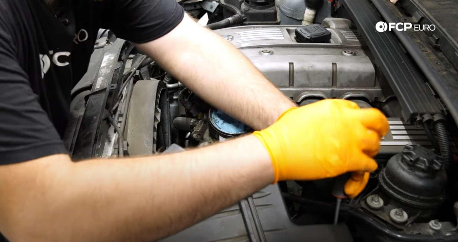 DIY BMW N52 Drive Belt Replacement loosening the intake hose clamp