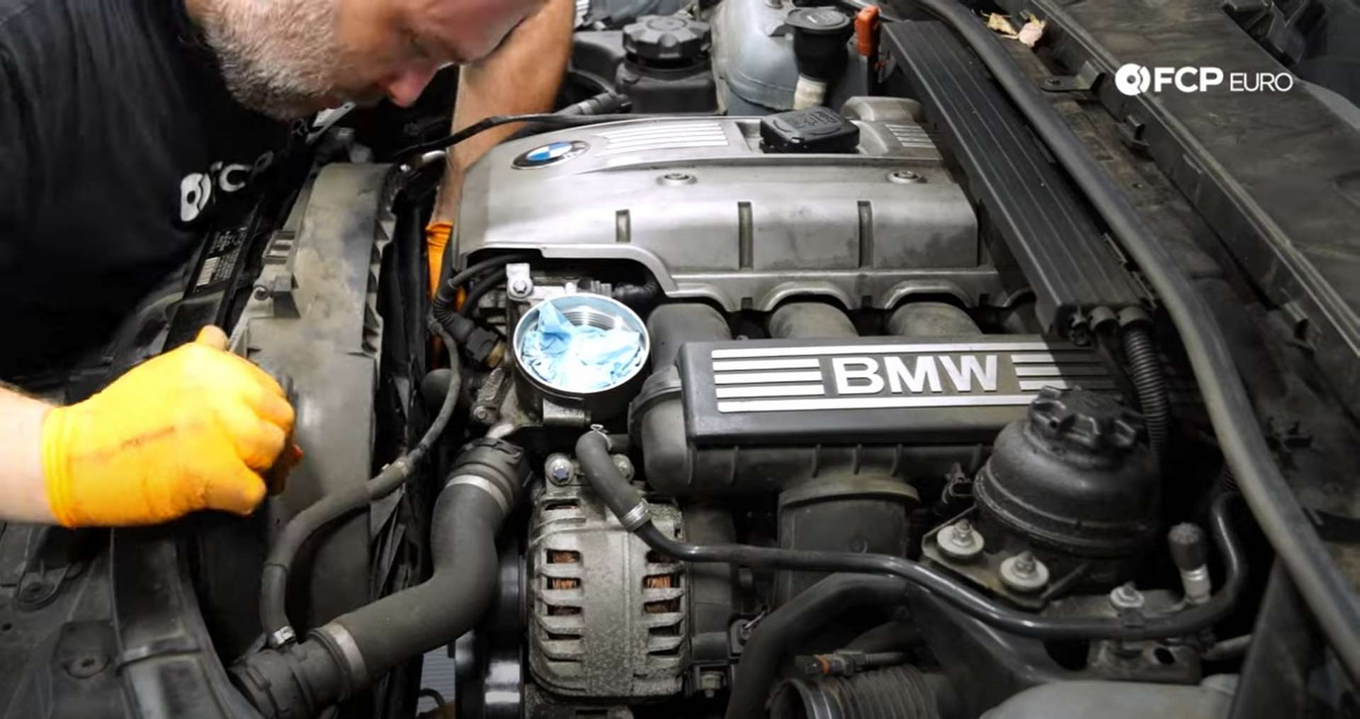 DIY BMW N52 Drive Belt Replacement removing the fan shroud