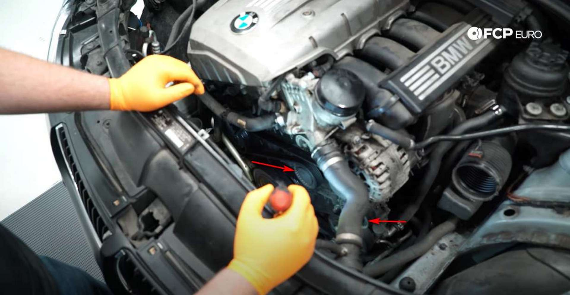 DIY BMW N52 Drive Belt Replacement pulley and tensioner cap locations