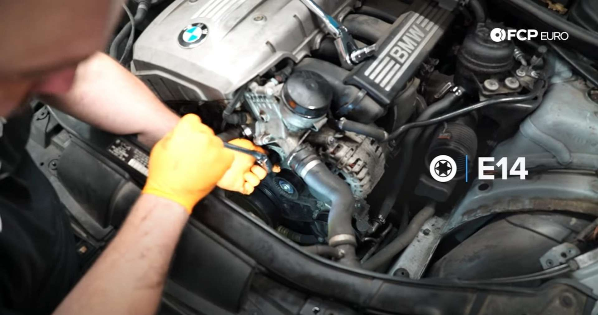 DIY BMW N52 Drive Belt Replacement removing the belt tensioner