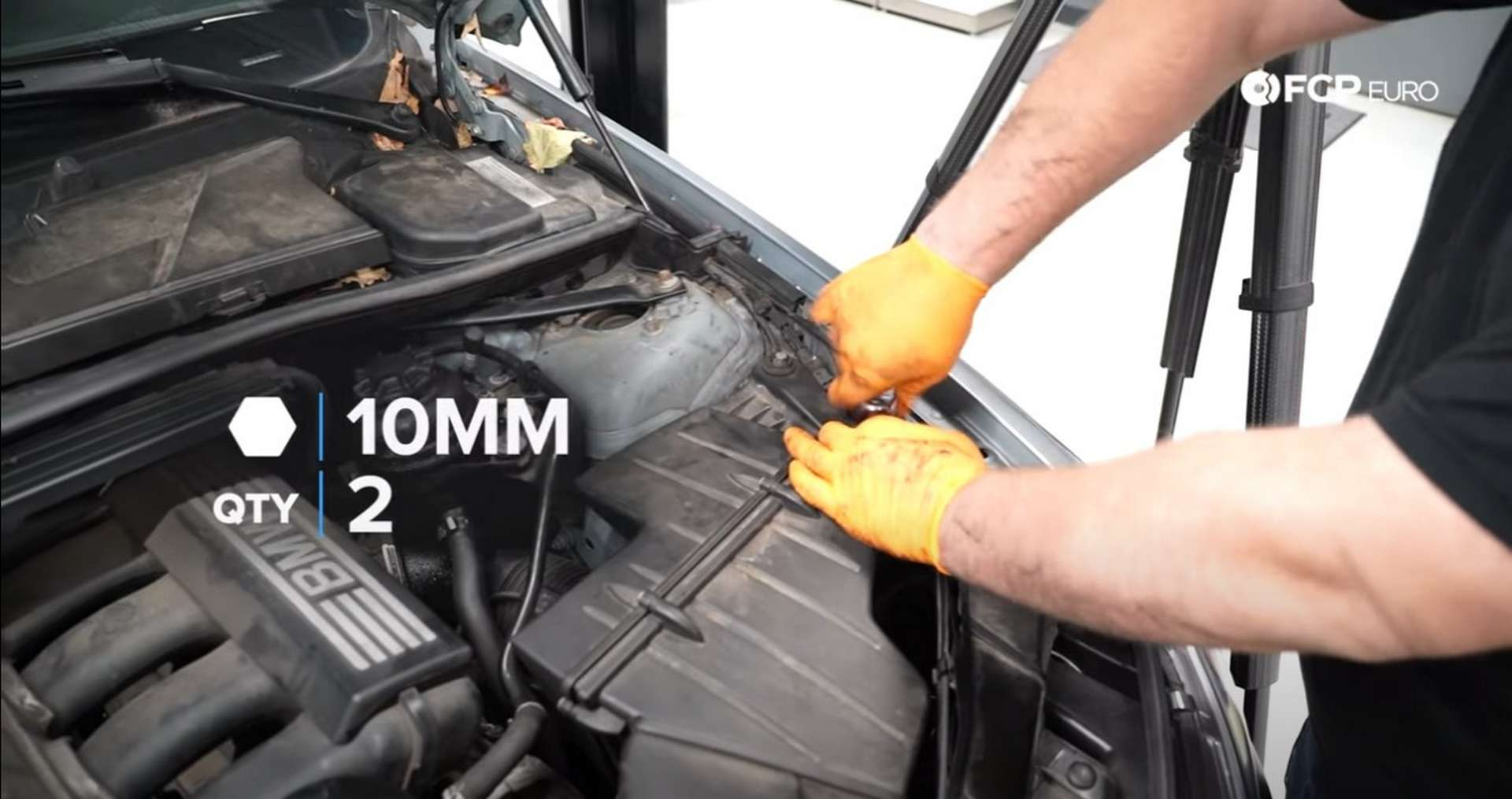 DIY BMW N52 Drive Belt Replacement tightening the airbox's mounting bolts