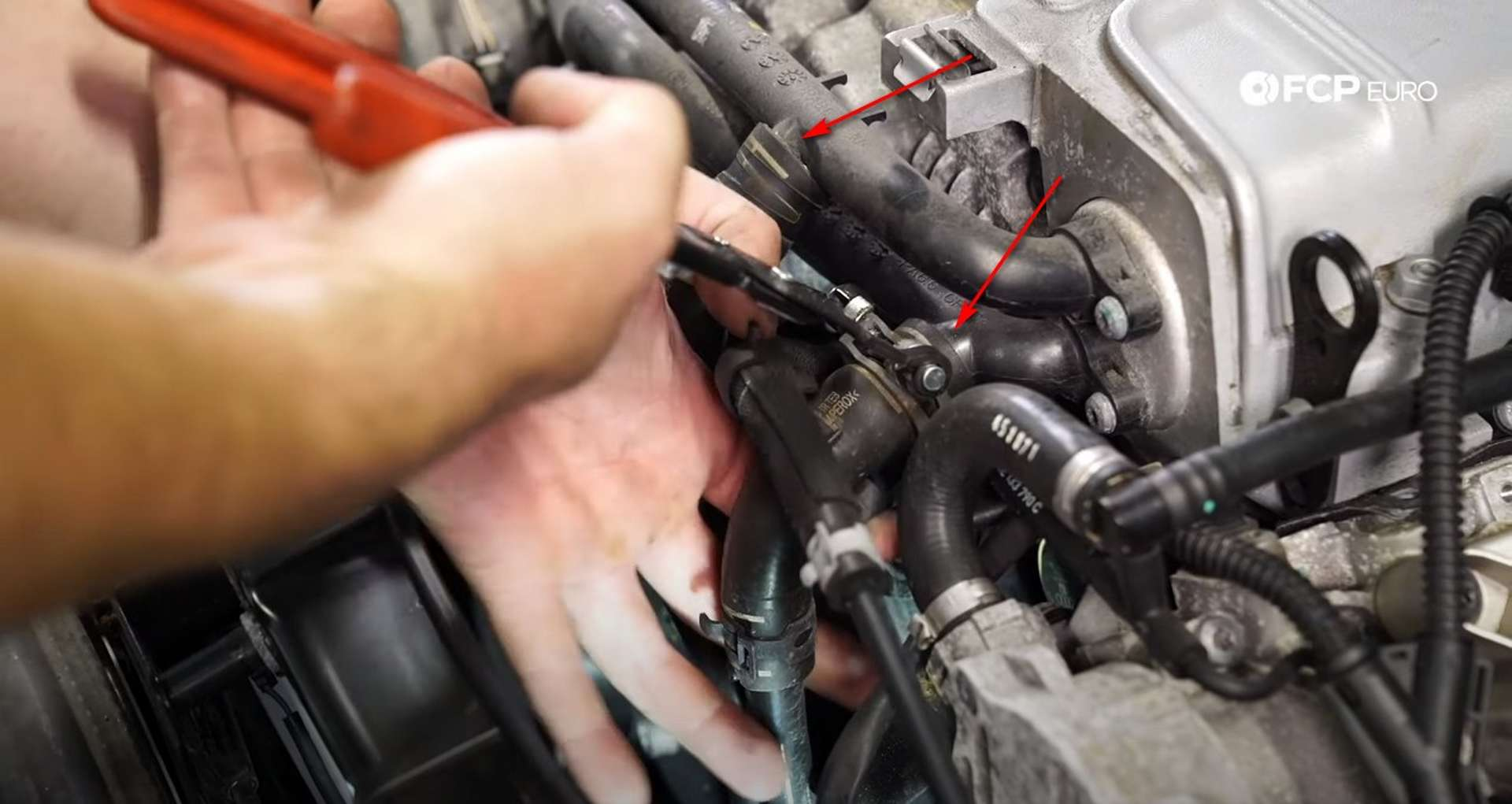 DIY Audi B8.5 Water Pump and Thermostat Replacement removing the coolant lines from the supercharger
