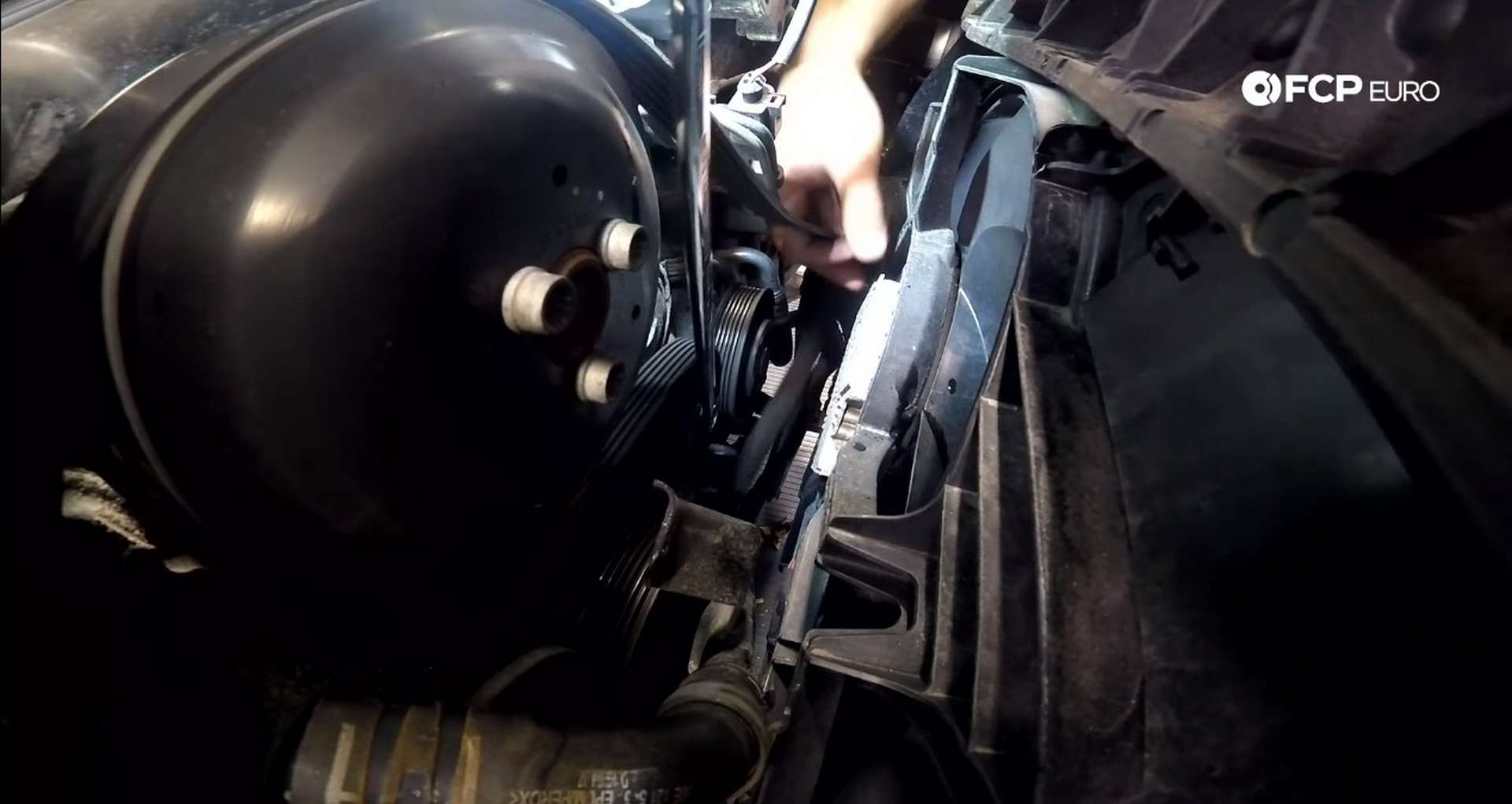 DIY Audi B8.5 Water Pump and Thermostat Replacement removing the tension from the accessory belt tensioner