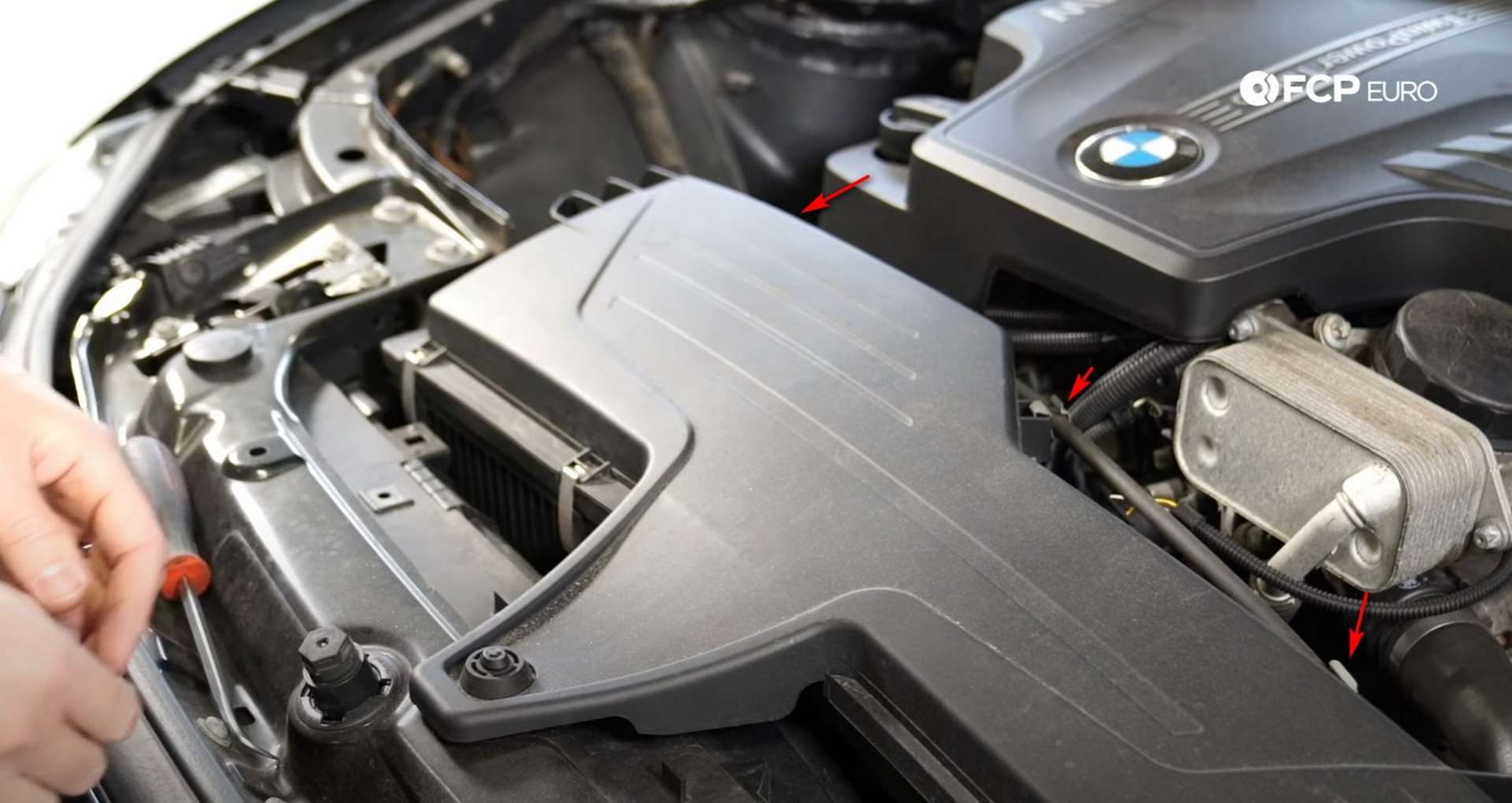 DIY BMW F30 Air Filter Replacement disconnecting the hood cable