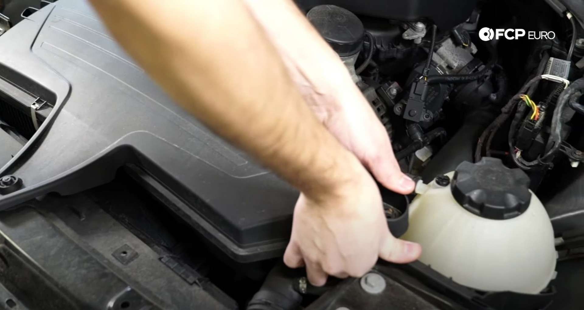 DIY BMW F30 Air Filter Replacement lifting the airbox cover off the grommets