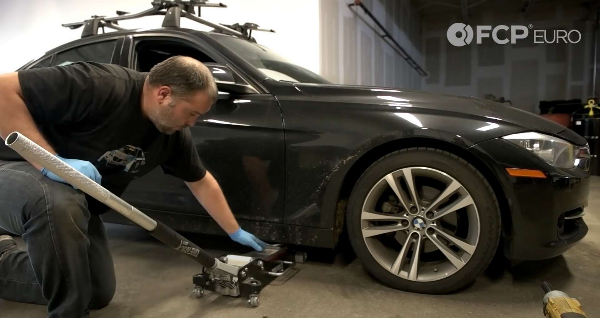 DIY BMW F30 Headlight Bulb Replacement lifting the car from the forward jack point
