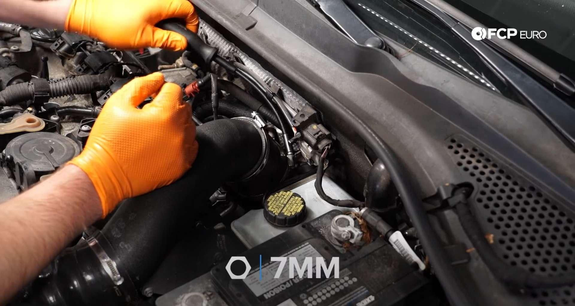 DIY MK7 VW GTI Turbocharger Upgrade loosening the intake clamp