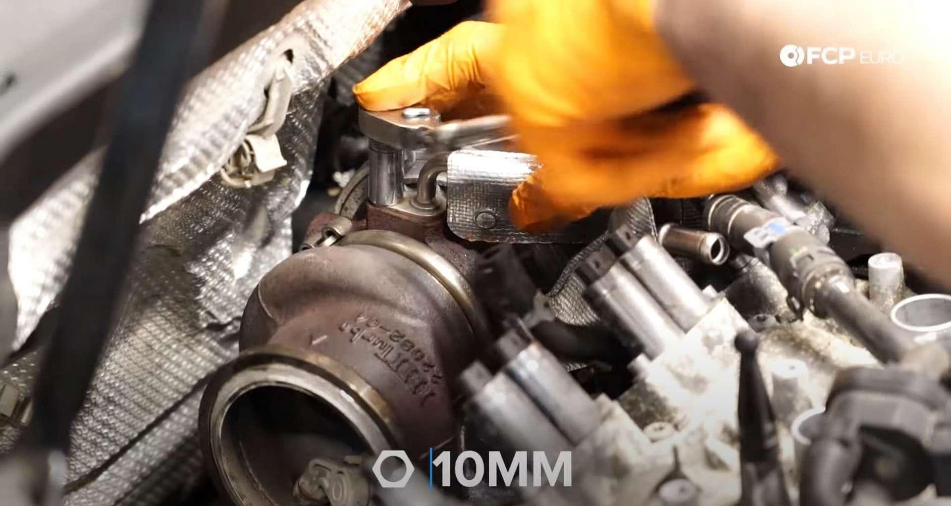 DIY MK7 VW GTI Turbocharger Upgrade removing oil feed line stud