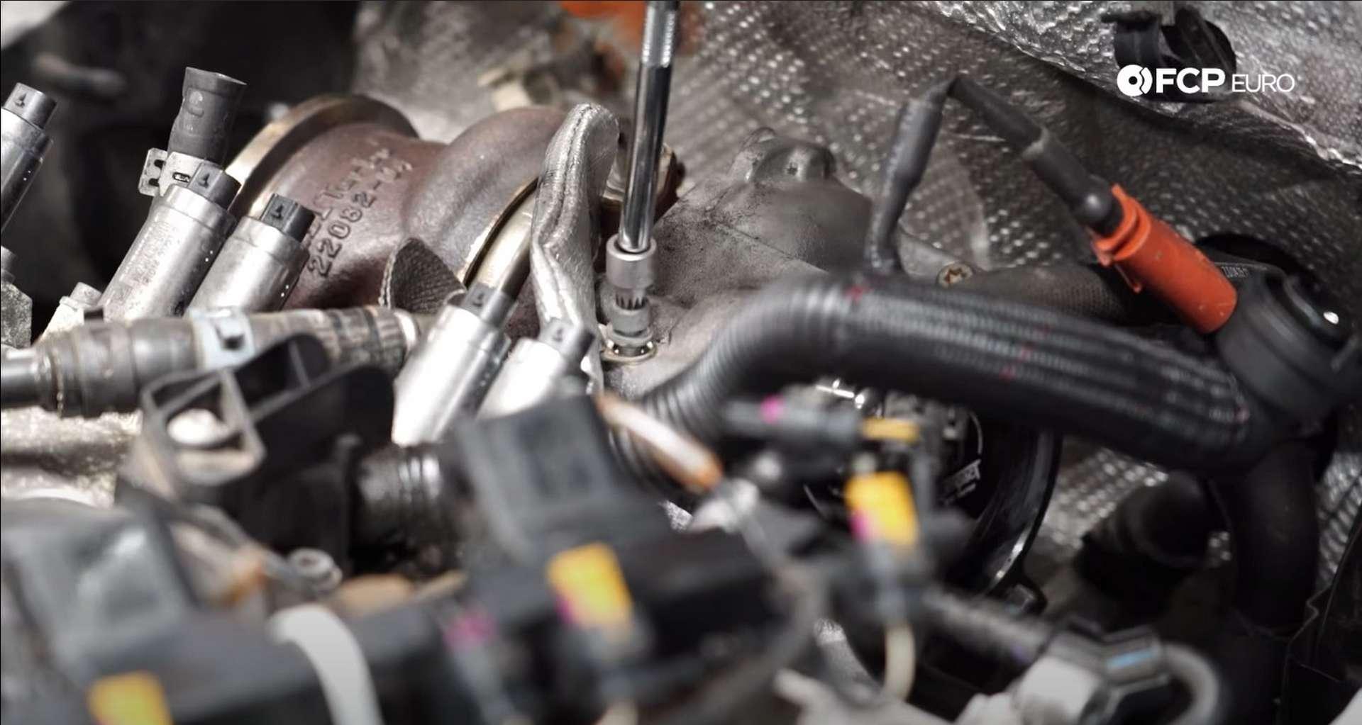 DIY MK7 VW GTI Turbocharger Upgrade removing oil feed line bracket bolt