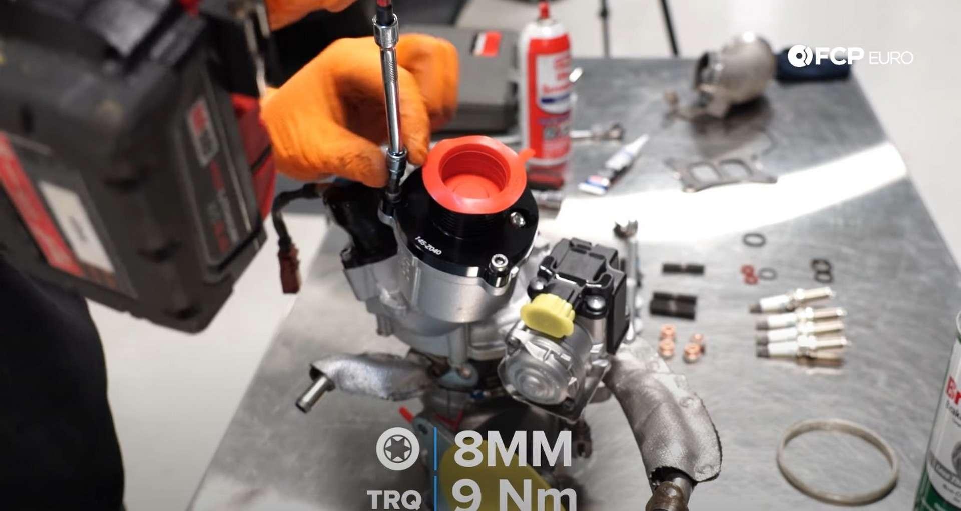 DIY MK7 VW GTI Turbocharger Upgrade tightening the turbo muffler bolts