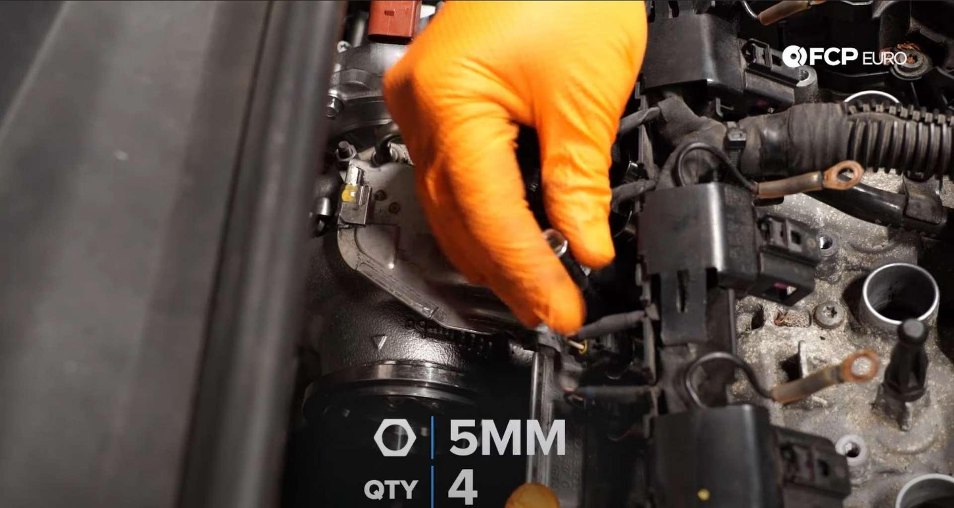 DIY MK7 VW GTI Turbocharger Upgrade installing the heat shield bolts