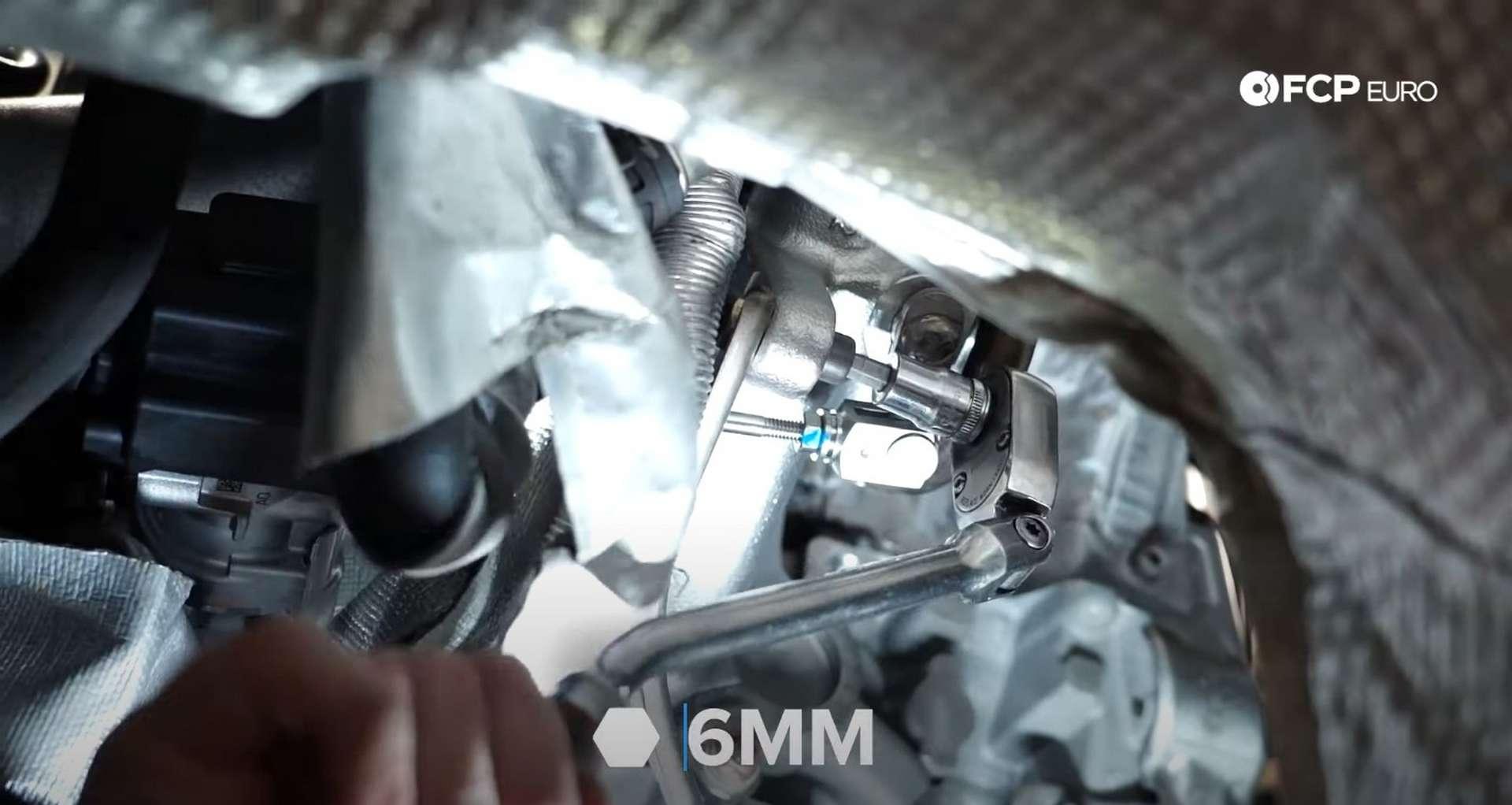 DIY MK7 VW GTI Turbocharger Upgrade installing the turbo support bracket