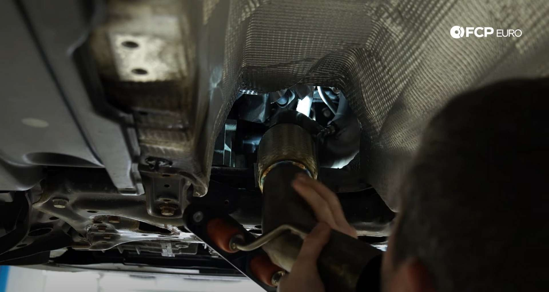 DIY MK7 VW GTI Turbocharger Upgrade fitting the downpipe into the engine bay