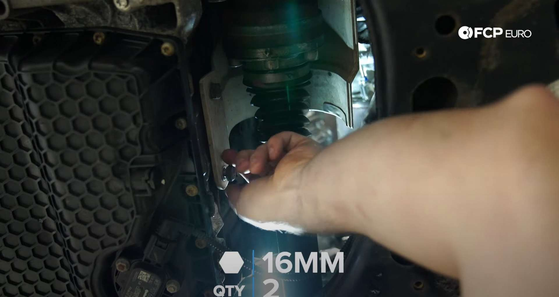 DIY MK7 VW GTI Turbocharger Upgrade installing the axle's heat shield
