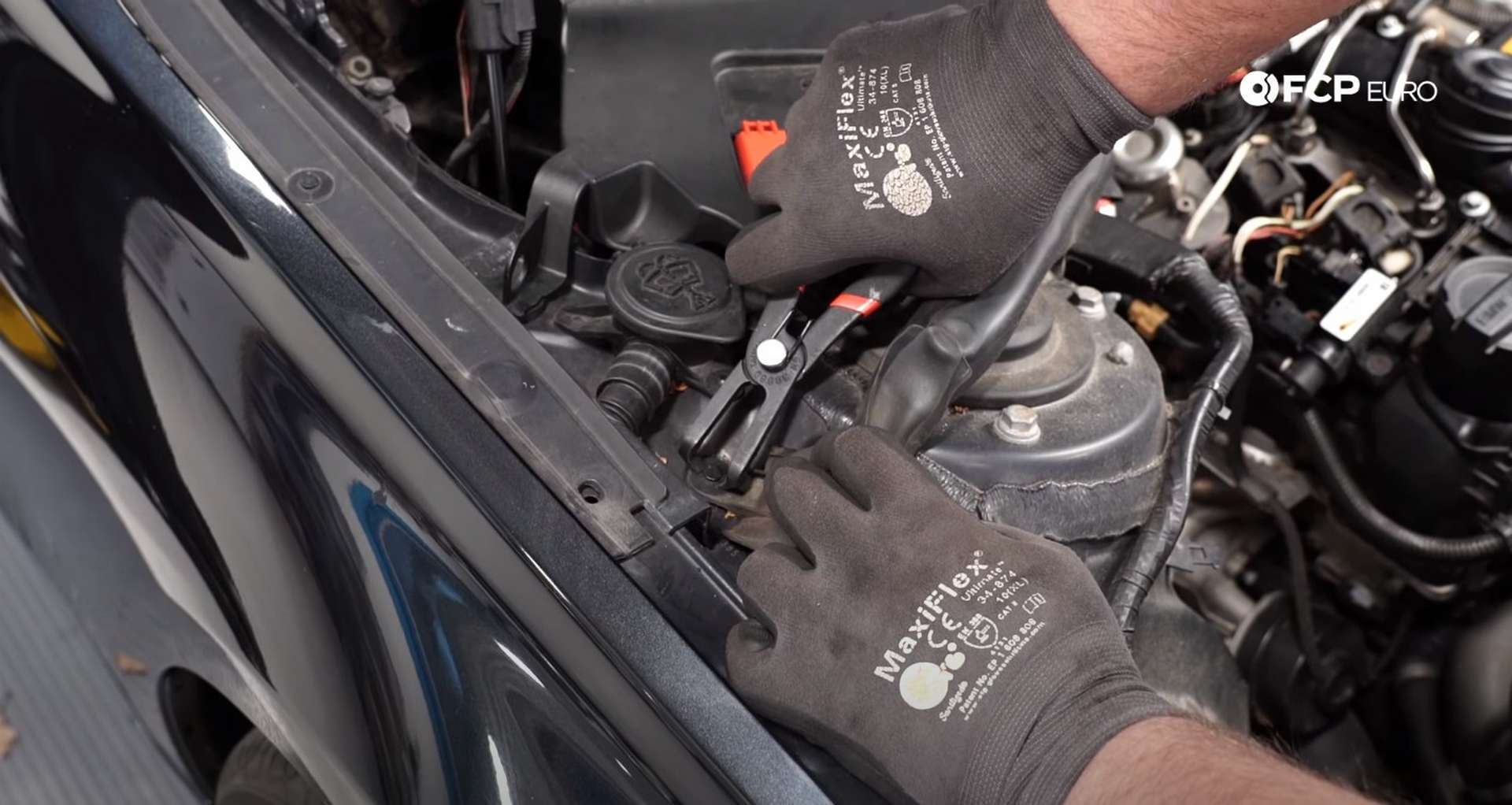 DIY BMW F30 High-Pressure Fuel Pump Replacement removing the cowl rivet