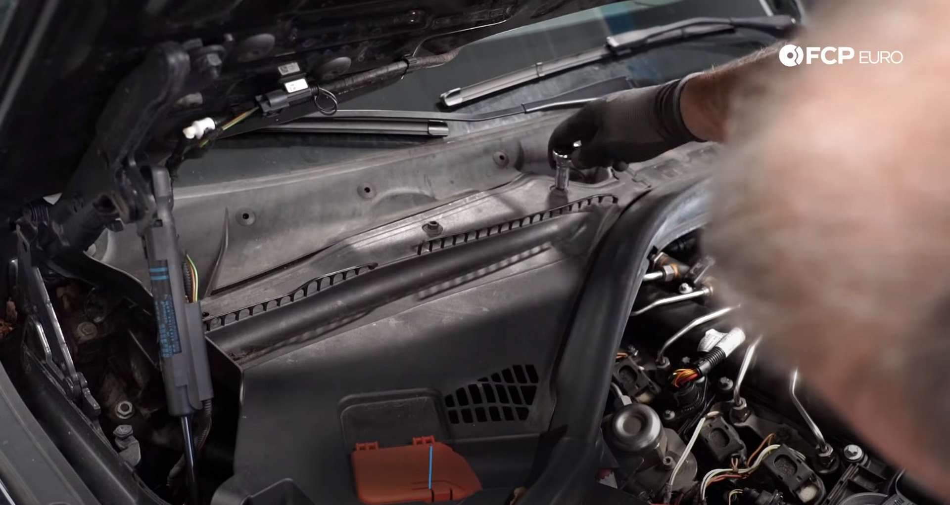 DIY BMW F30 High-Pressure Fuel Pump Replacement turning the cowl's fasteners